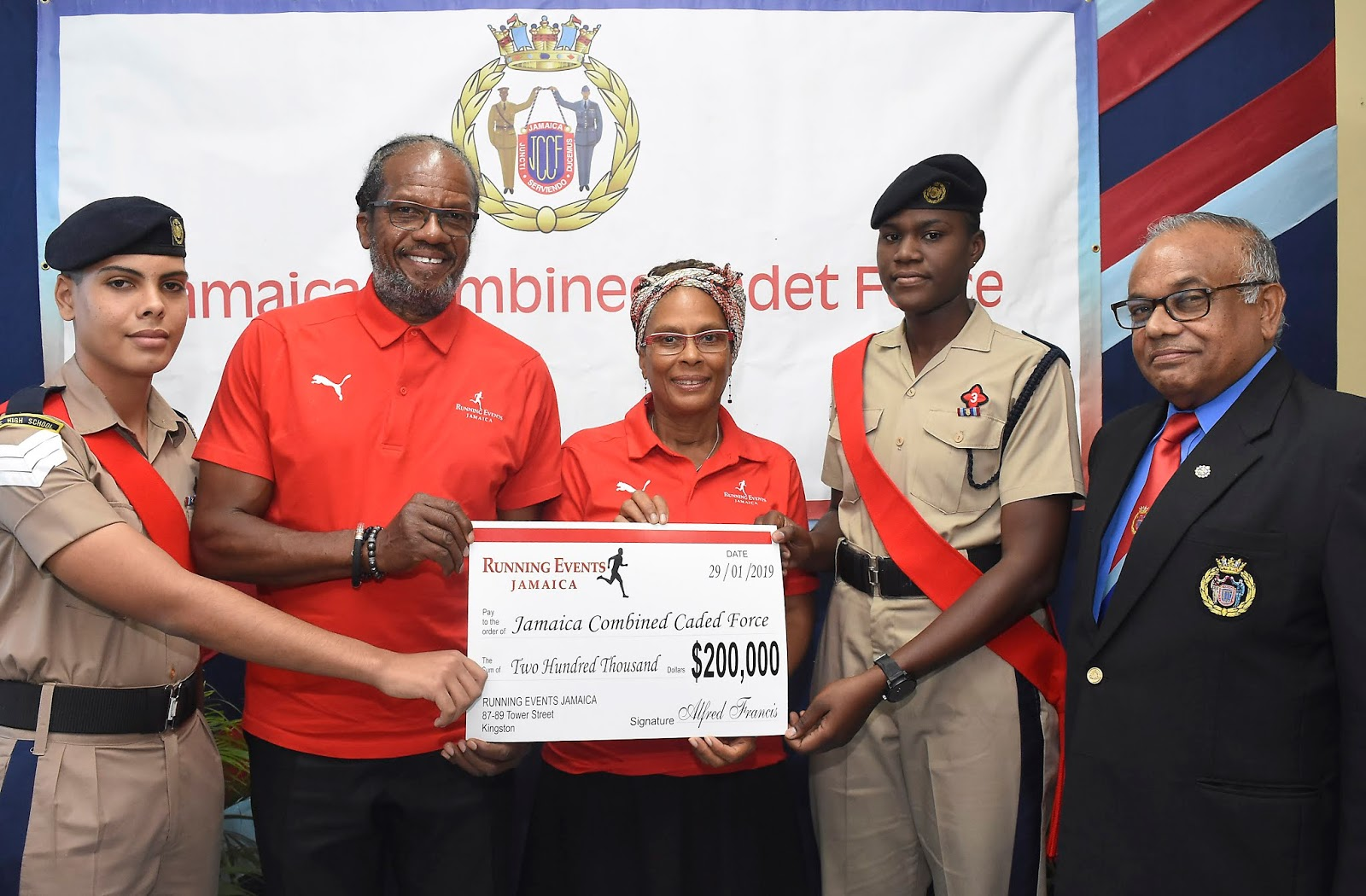 "Sergeant Nathanael Scarlett, Alfred ""Frano"" Francis managing director of Running Events Jamaica, Diane Ellis director at Running Events Jamaica, Sergeant Paula-Ann Burton and Colonel the Honourable Errol Johnson participates in a cheque presentation at the Jamaica Combined Cadet Force (JCCF) Headquarters on Tuesday, January 30, 2019. The presentation was a $200,000 donation to the JCCF by Running Events Limited."