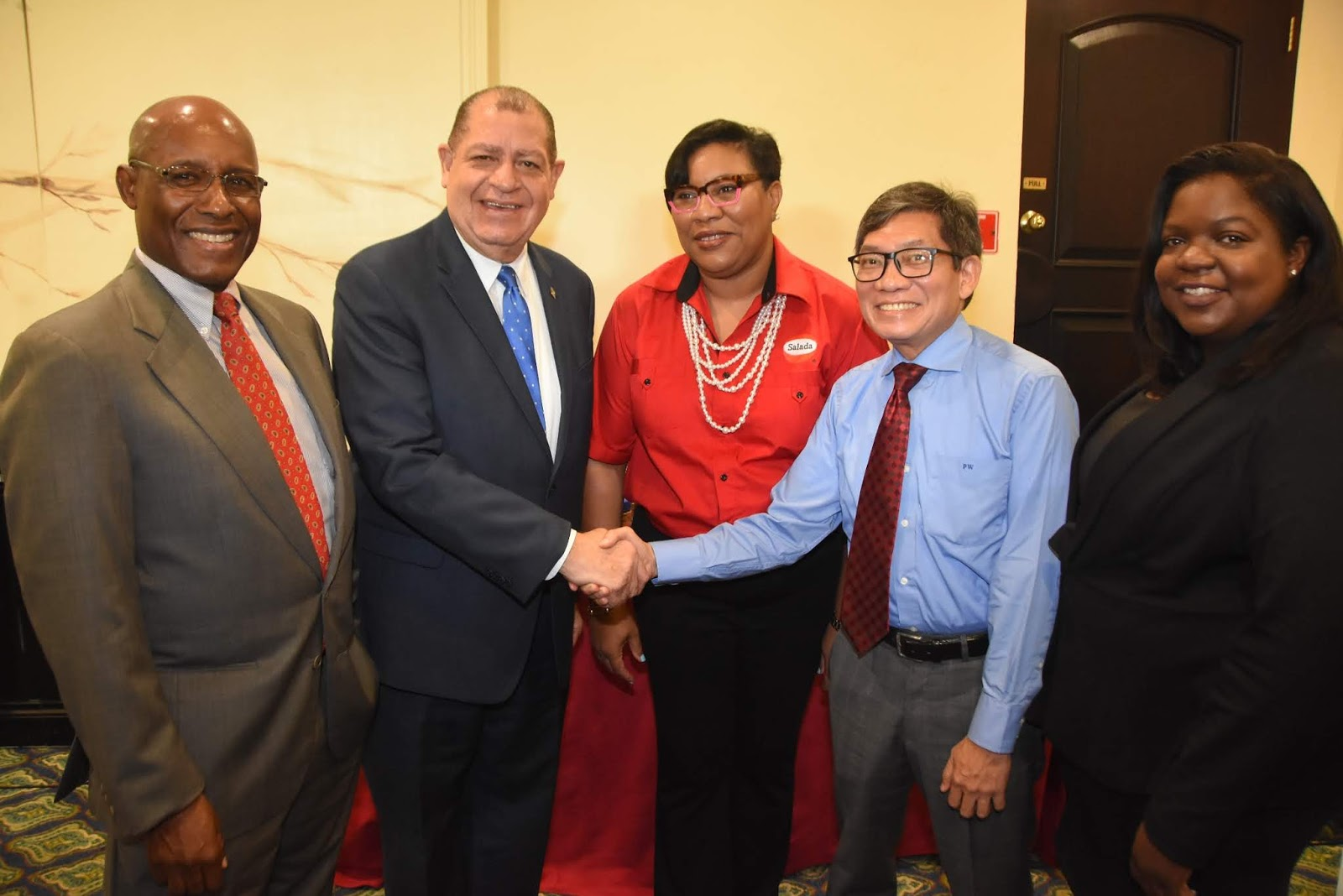 The Hon. Audley Shaw (second left), Minister of Industry, Commerce, Agriculture and Fisheries congratulates the Salada team on their initiative to utilize $100M to purchase 25,000 boxes of coffee cherries directly from farmers over a three-month period as noted at the press briefing held on Monday November 19, 2018, at the Courtleigh Hotel. Sharing in the moment are (from left) Senator the Hon. Aubyn Hill, Permanent Secretary in the Ministry of Industry, Commerce, Agriculture and Fisheries; Dianna Blake-Bennett , General Manager of Salada Foods Jamaica; Patrick Williams, Chairman of Salada Foods Jamaica; and Kathryn Lewis, Board Director at Salada Foods Jamaica.