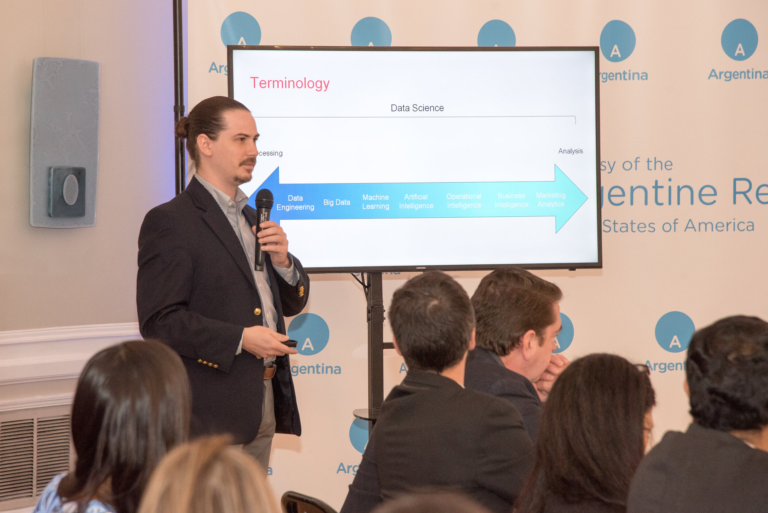Scott Crespo discussing the diverse terminology and disciplines in the data science field.  Photo courtesy of the Argentinian Embassy.