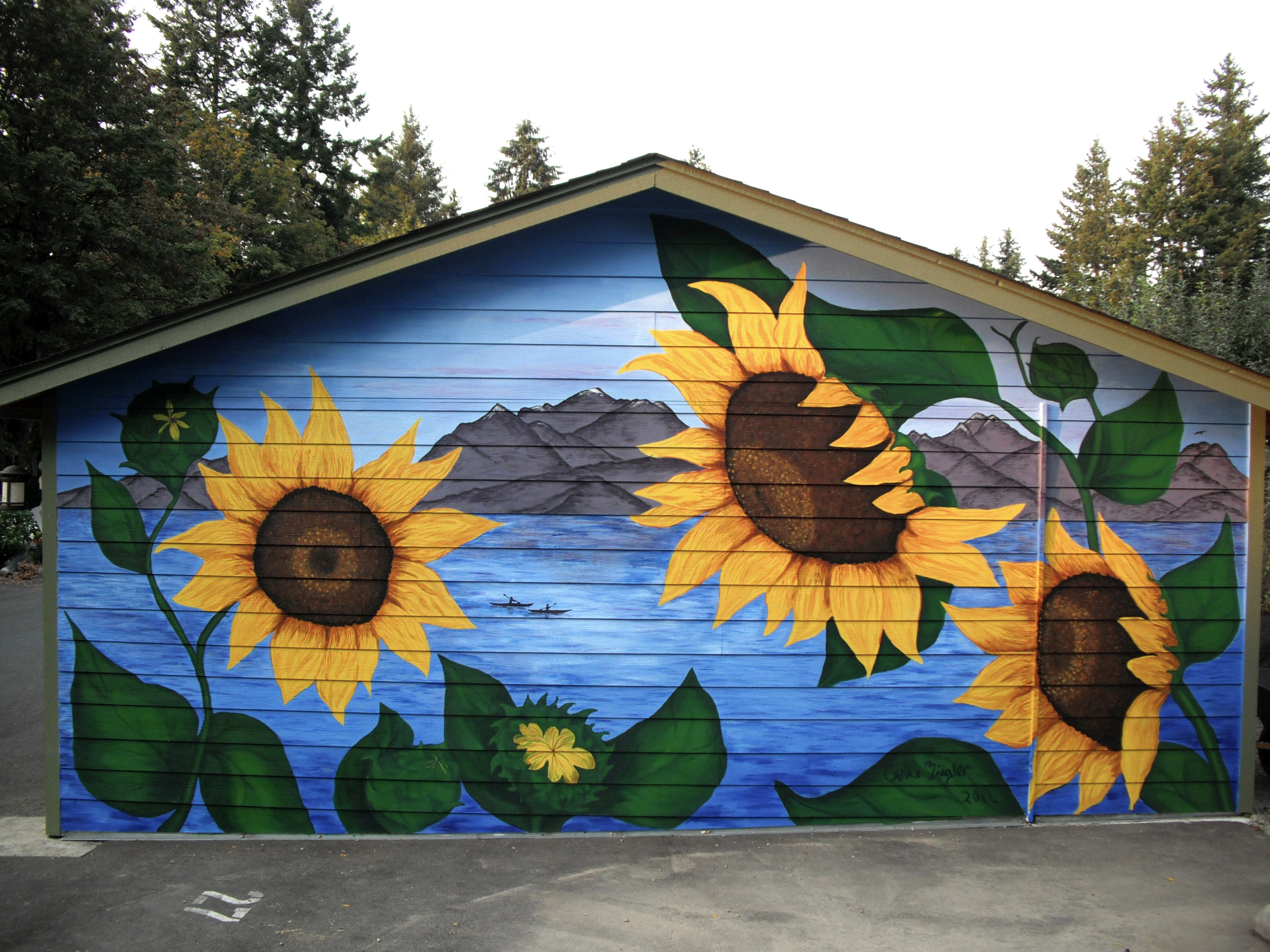 Sunflowers Mural   This bold and beautiful mural represents and welcomes visitors to Woodard Lane Cohousing.  Woodard Lane Cohousing, 1620 Woodard Ave NW, Olympia, WA 98502