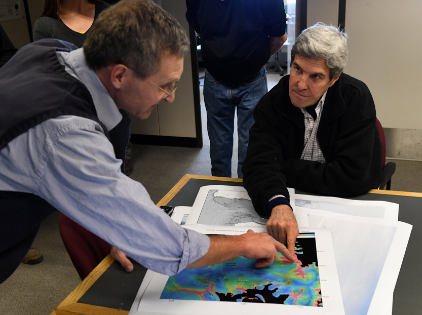 Then-U.S. Secretary of State John Kerry, right, listens to geologist John Stone at the Crary Science and Engineering Center in Antarctica.  Image credit: Mark Ralston via AP