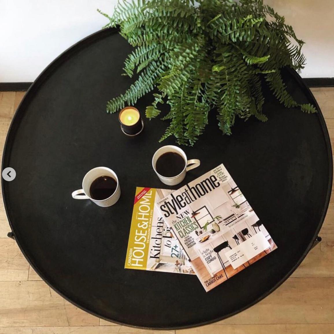 THREE LEGGED, CIRCULAR STEEL COFFEE TABLE