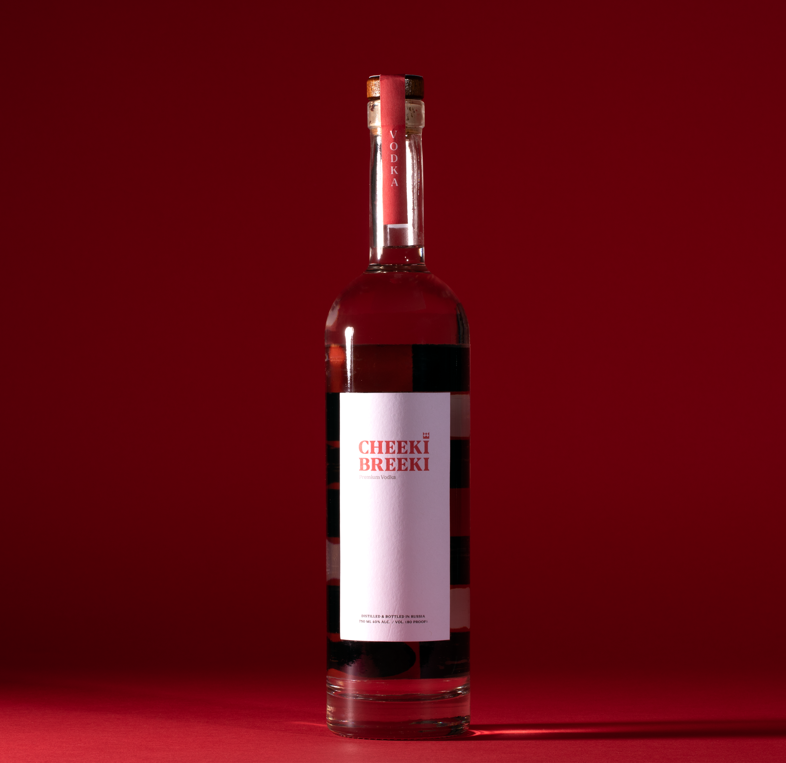 Cheeki Breeki Vodka Bottle on Red Background