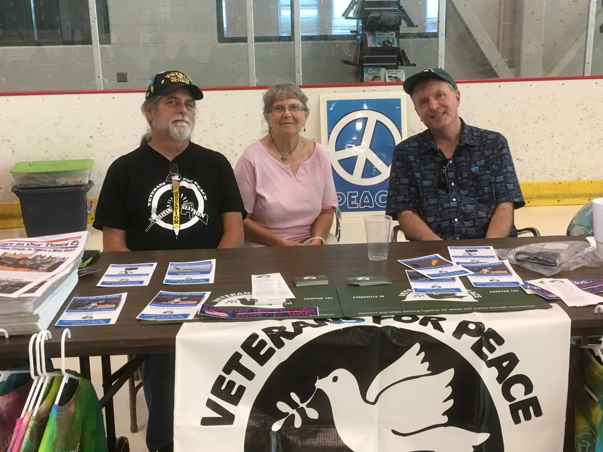 Veteran member Stan Lightner and associate members Caroline Nellis and John O'Leary people the VFP table (while veteran member Alan Williamson snaps this photo) at Swonder Arena during a recent match between Evansville's Demolition City Roller Derby and the Dark River Derby Coalition from Quincy, Illinois. Stan read the VFP statement of purpose over the PA during halftime to an attentive and respectful audience. Although the visiting team prevailed, Evansville's hometown ladies showed extraordinary tenacity and grit!