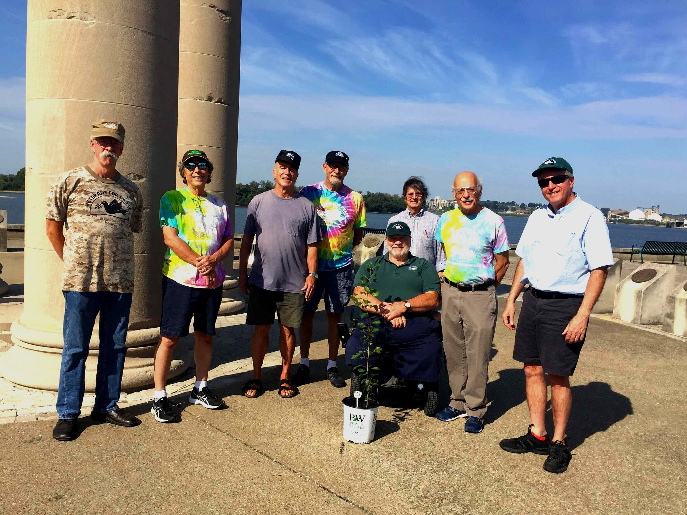 "Members of Evansville Veterans For Peace gather at the Four Freedoms Monument on International Peace Day, September 21, 2019, to share a statement on ""Climate Action For Peace"" and to present the City of Evansville a viable linden start from the International World War Peace Tree. From left: Dan Linthicum, Alan Williamson, Larry Miller, Dave Helfrich, Gary May, Thom Moor, Lynn Kinkade and John O'Leary. Photo: Liz Becker and Tas."