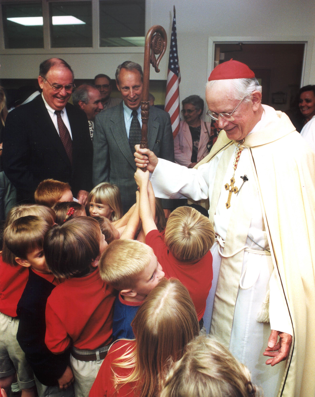 Cardinal James Hickey dedicates the school in 1997.
