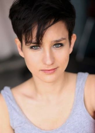 Bex Taylor-Klaus - Plays NORA - Conspiracy theorist and student at Cobb University under the guidance of Blair's husband, Andrew.