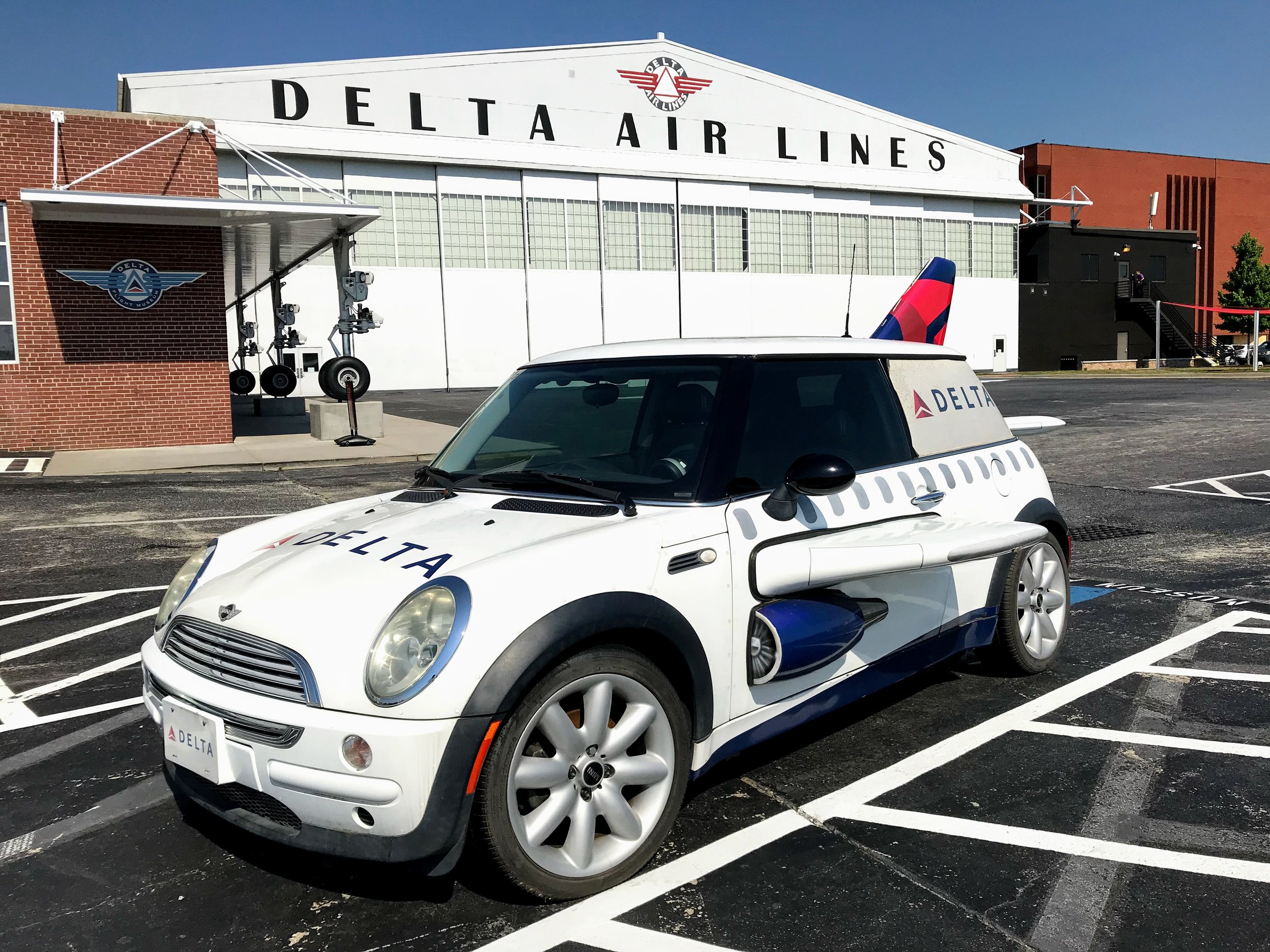 A Delta themed Mini outside of the Delta Flight Museum