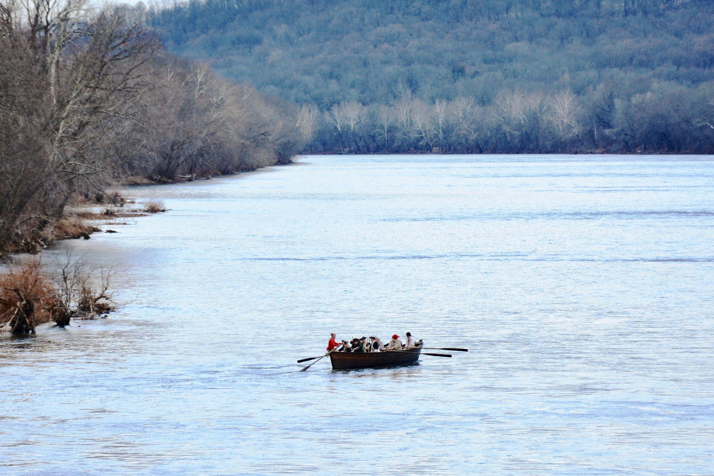 Actors reenact General Washington's historic Christmas Day crossing of the Delaware River.
