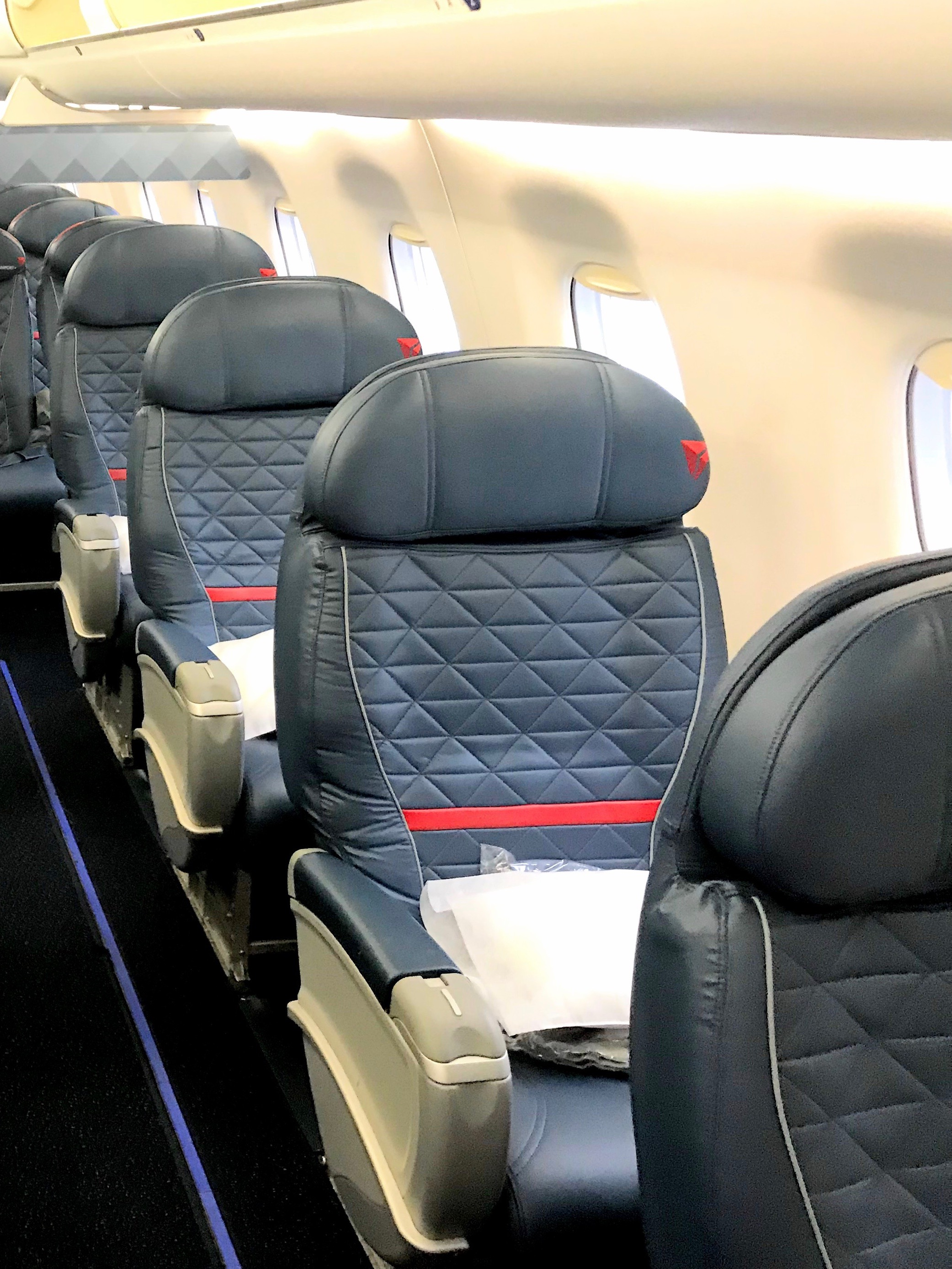 Seat 1A is 1 of 4 single seats in the First Class cabin
