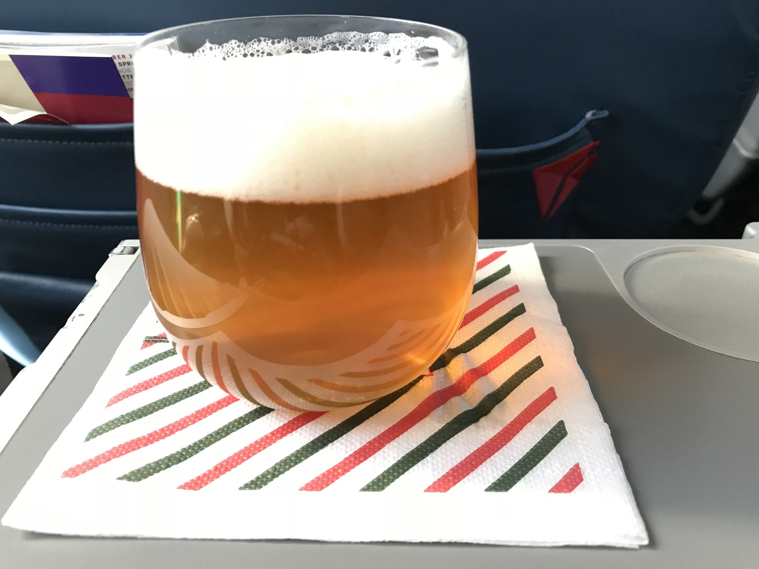 The tray table folds out of the right arm rest.