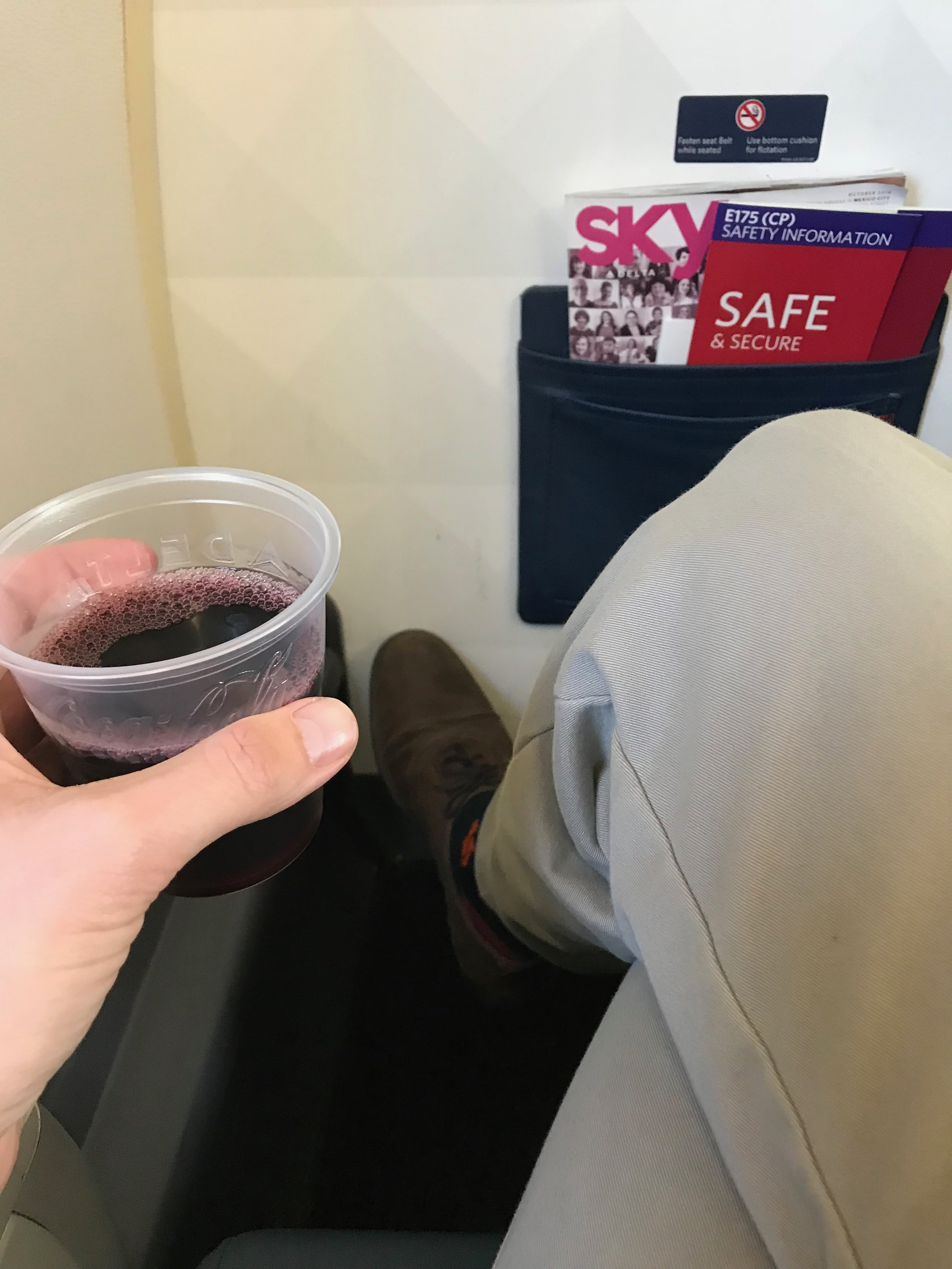 There is more knee space than the other rows, but there is not as much room to stretch your legs. There is also no under seat stowage.
