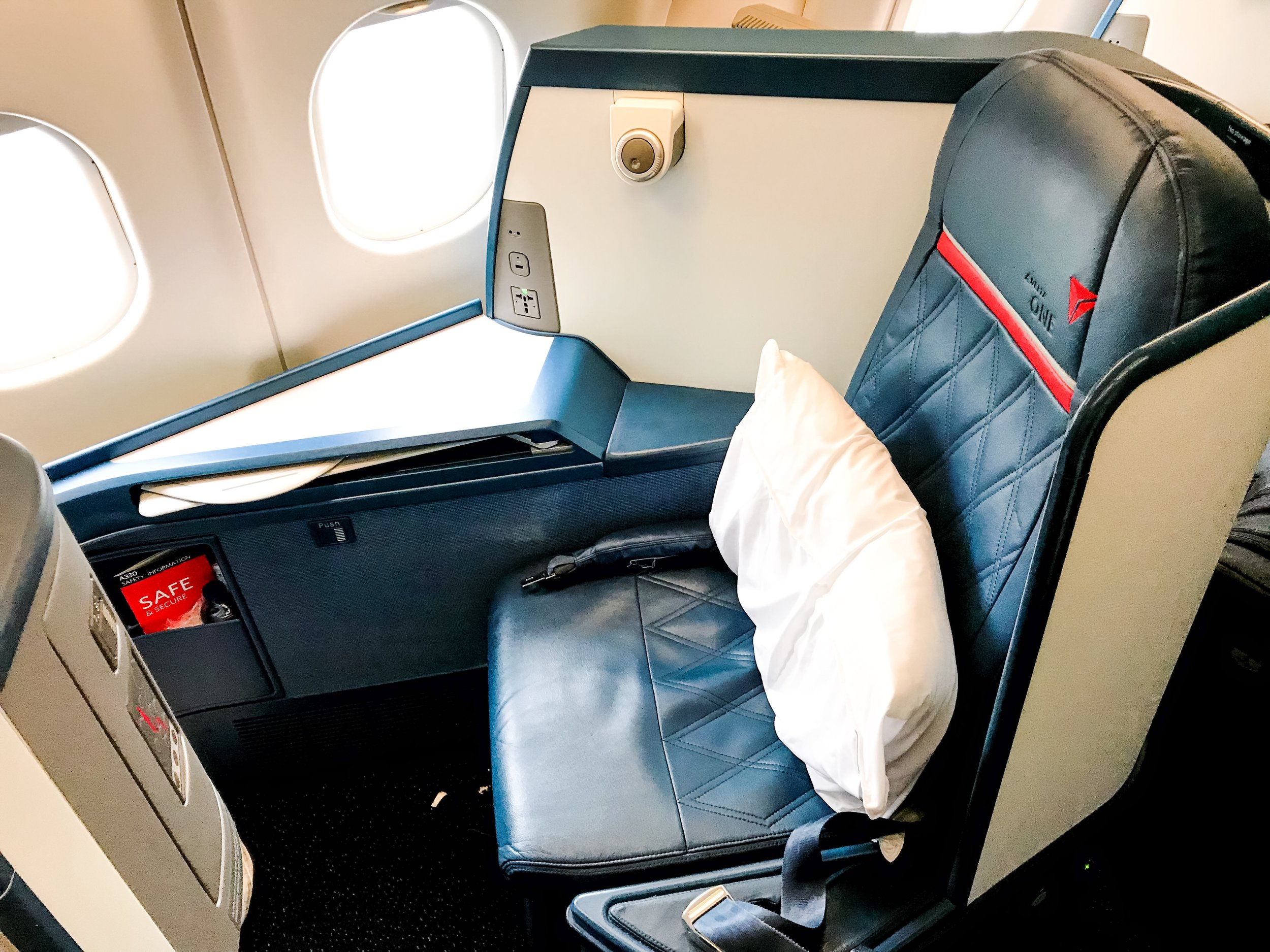 The seats are very comfortable and have ample space to place small personal belongings. That is a frequent complaint about some premium cabins.
