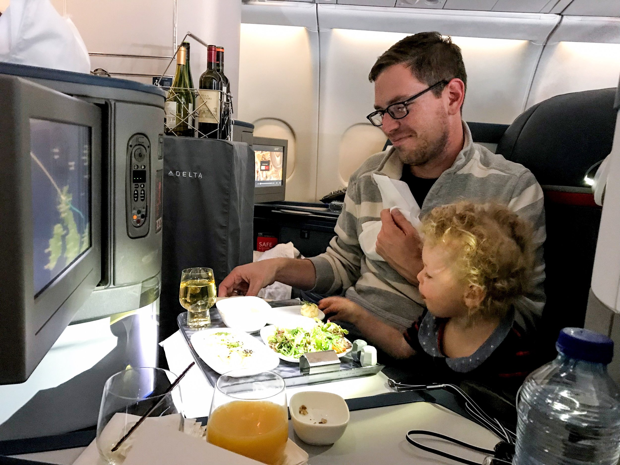 Drinks were initially served from a beverage cart during the meal. But after the meal was done, flight attendants walked around the cabin with bottles of wine.