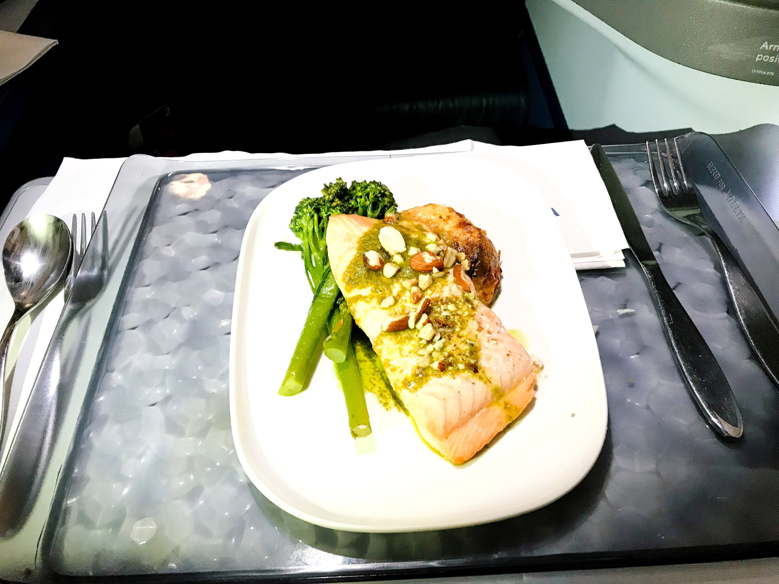 The main course was a salmon filet over a bed of rice and vegetables. The salmon was very moist and not dried out, which is a common occurrence on flights.
