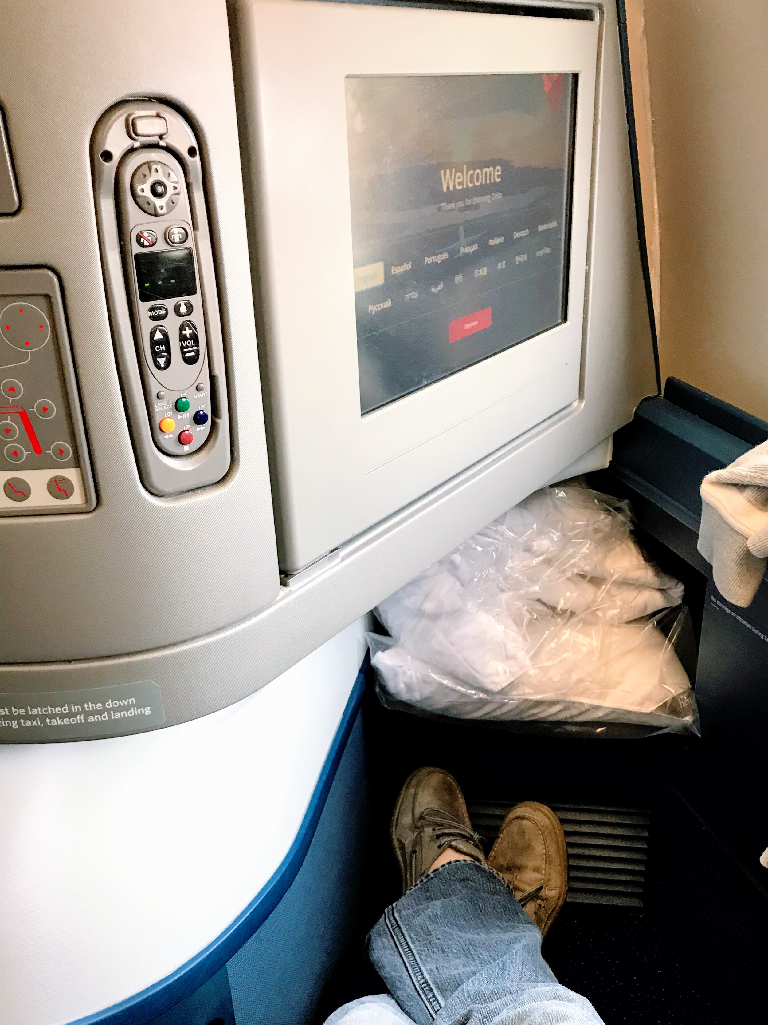 You can store your duvet and pillow on the foot rest when you aren't using them and won't sacrifice legroom. I'm 6' and couldn't reach the foot rest.