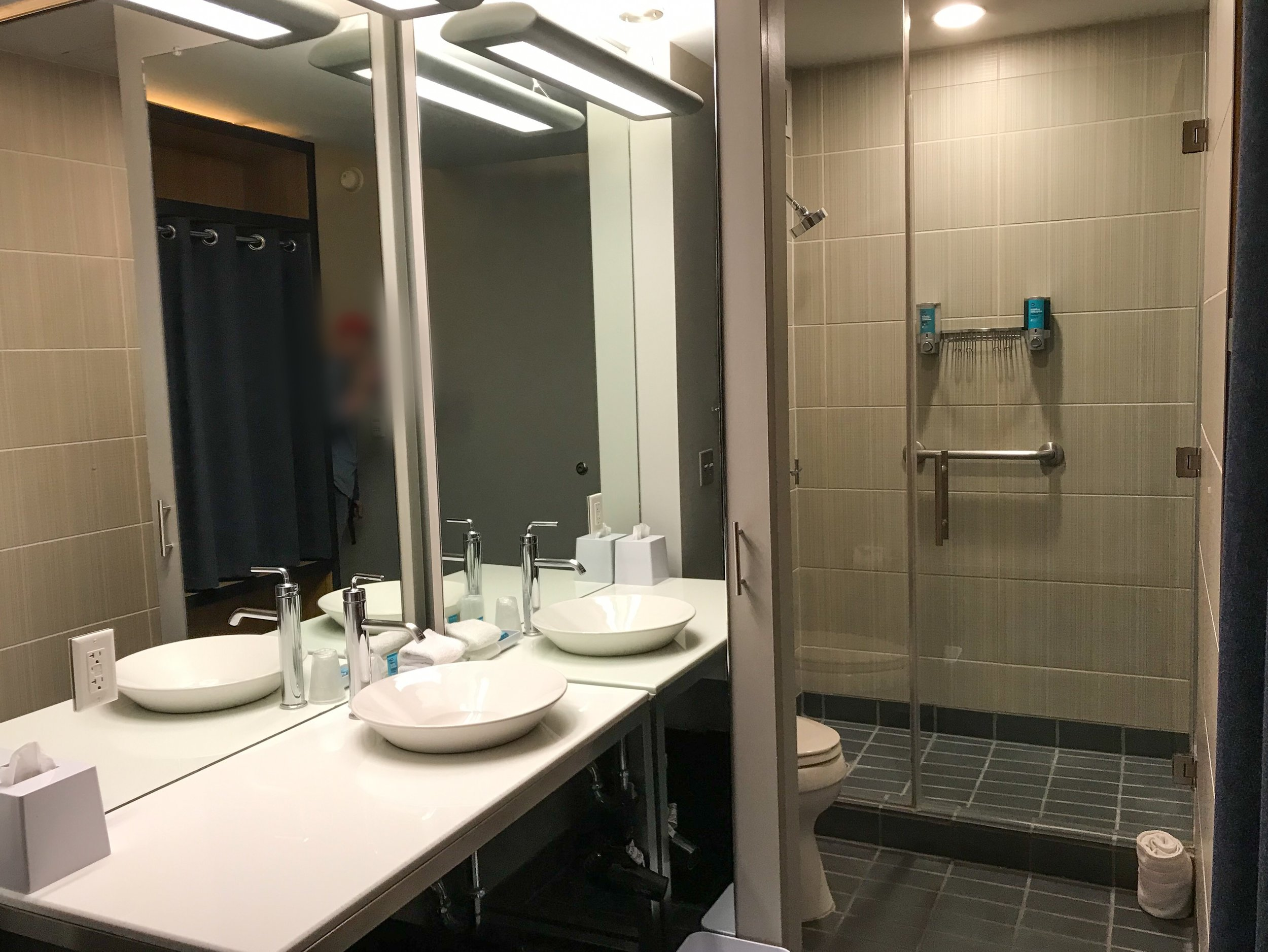 The bathroom only had one sink, but had a large counter.