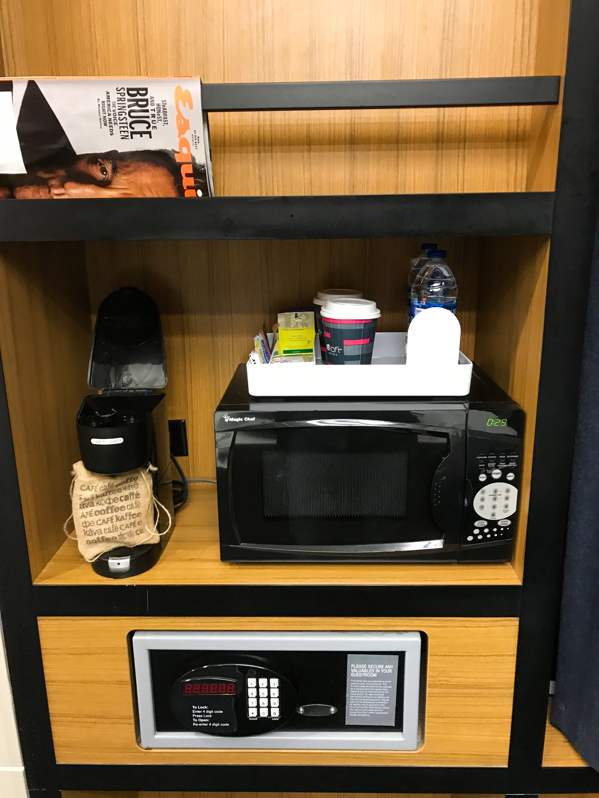 The room had a microwave, coffee station, and safe.