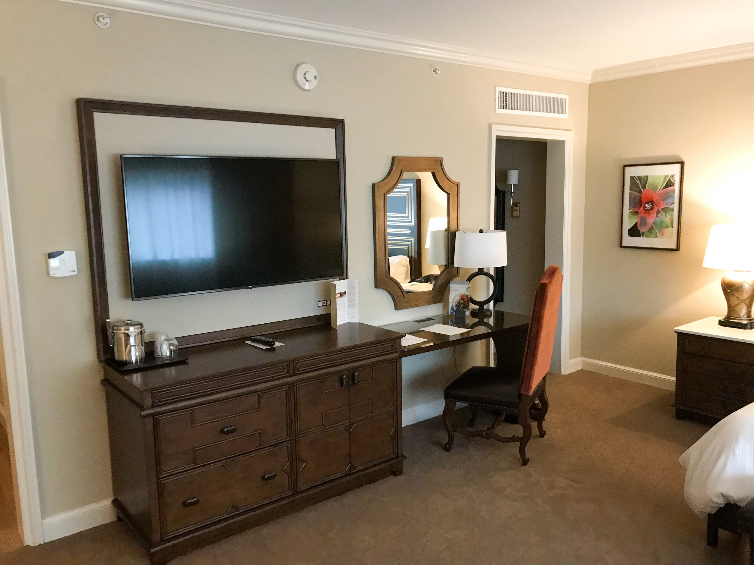 Large TV and desk.