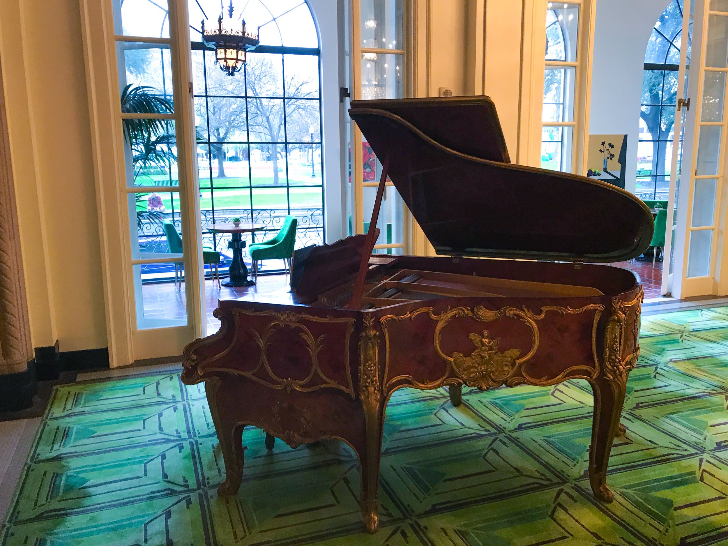 A grand piano in the lobby.