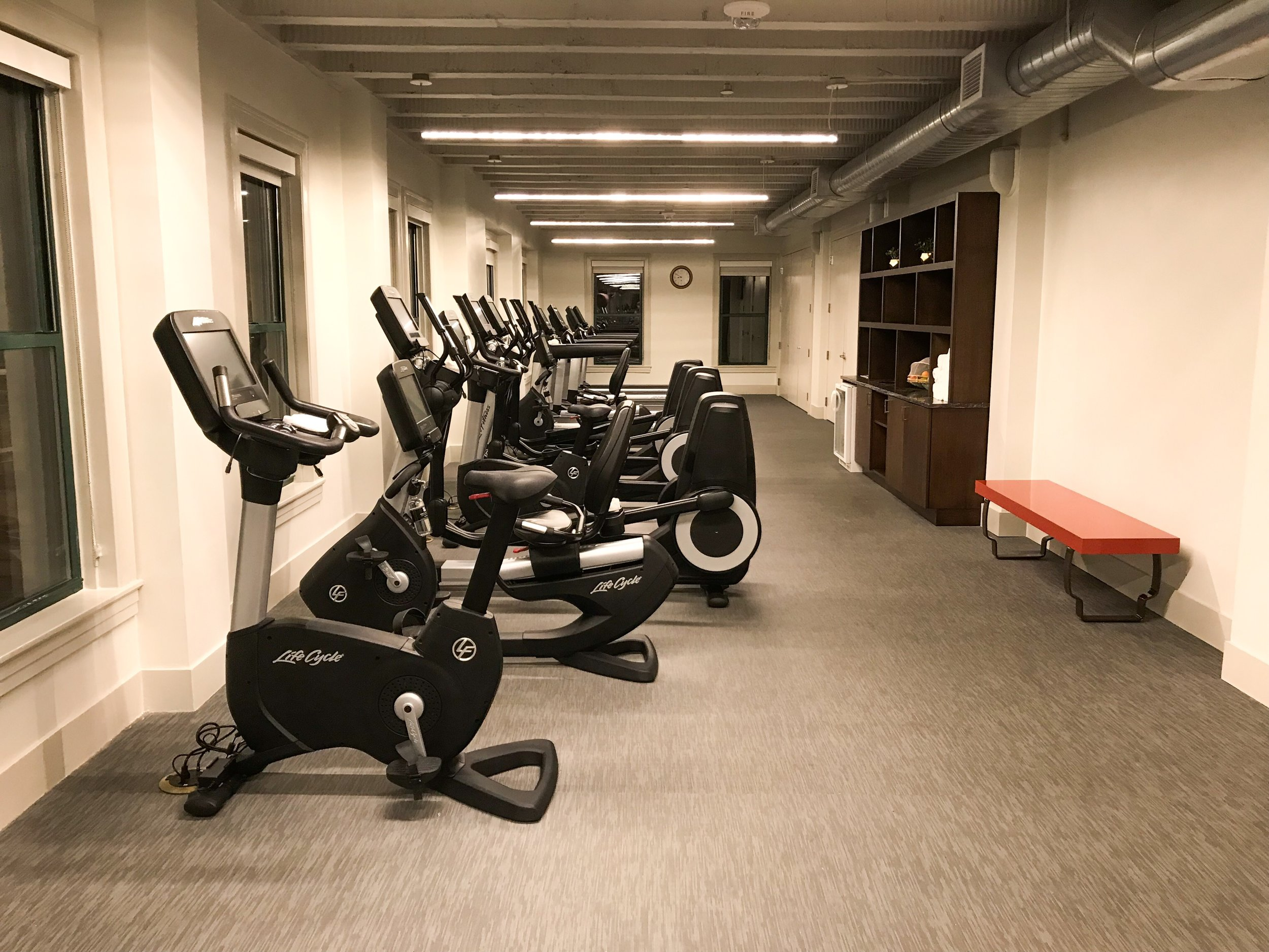 The workout room had several treadmills and stationary bikes, as well as complimentary water and towels.