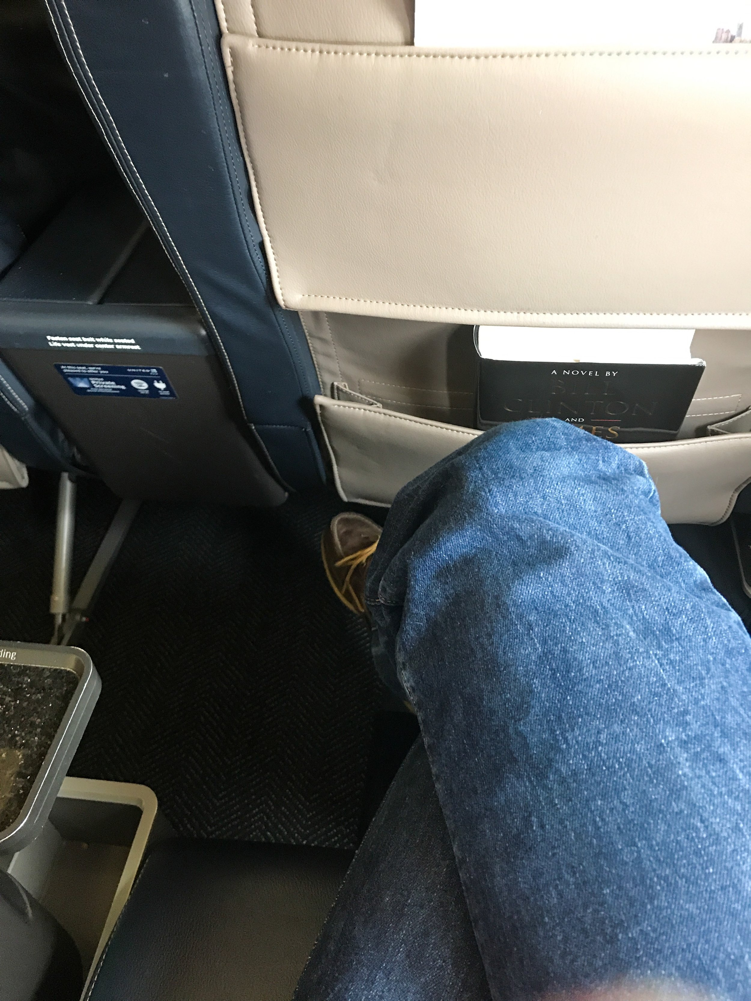 People complain that seat pitch even in domestic First Class has decreased over the years, but it still offers plenty of legroom.