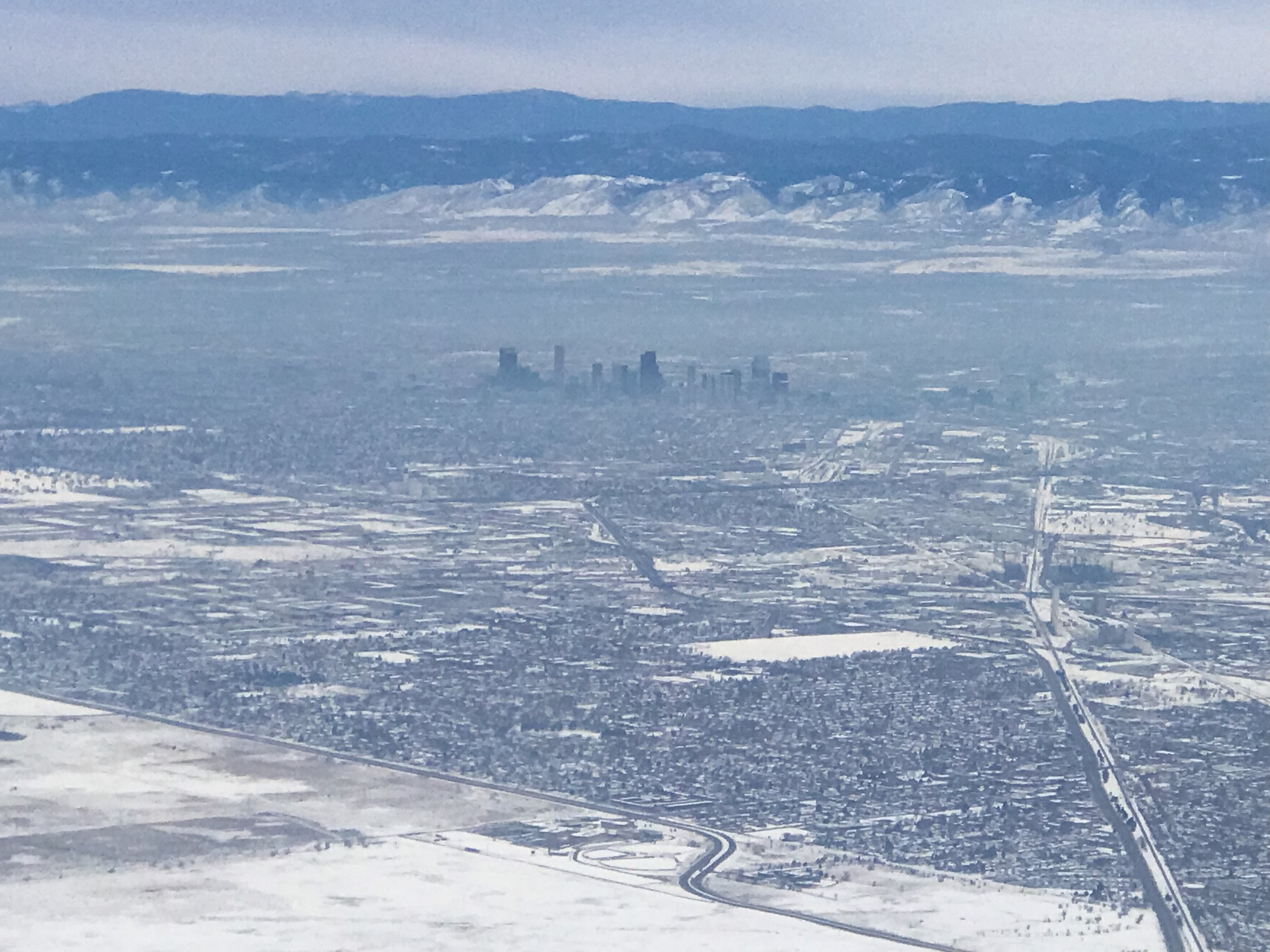 Downtown Denver in the distance as we flew west.