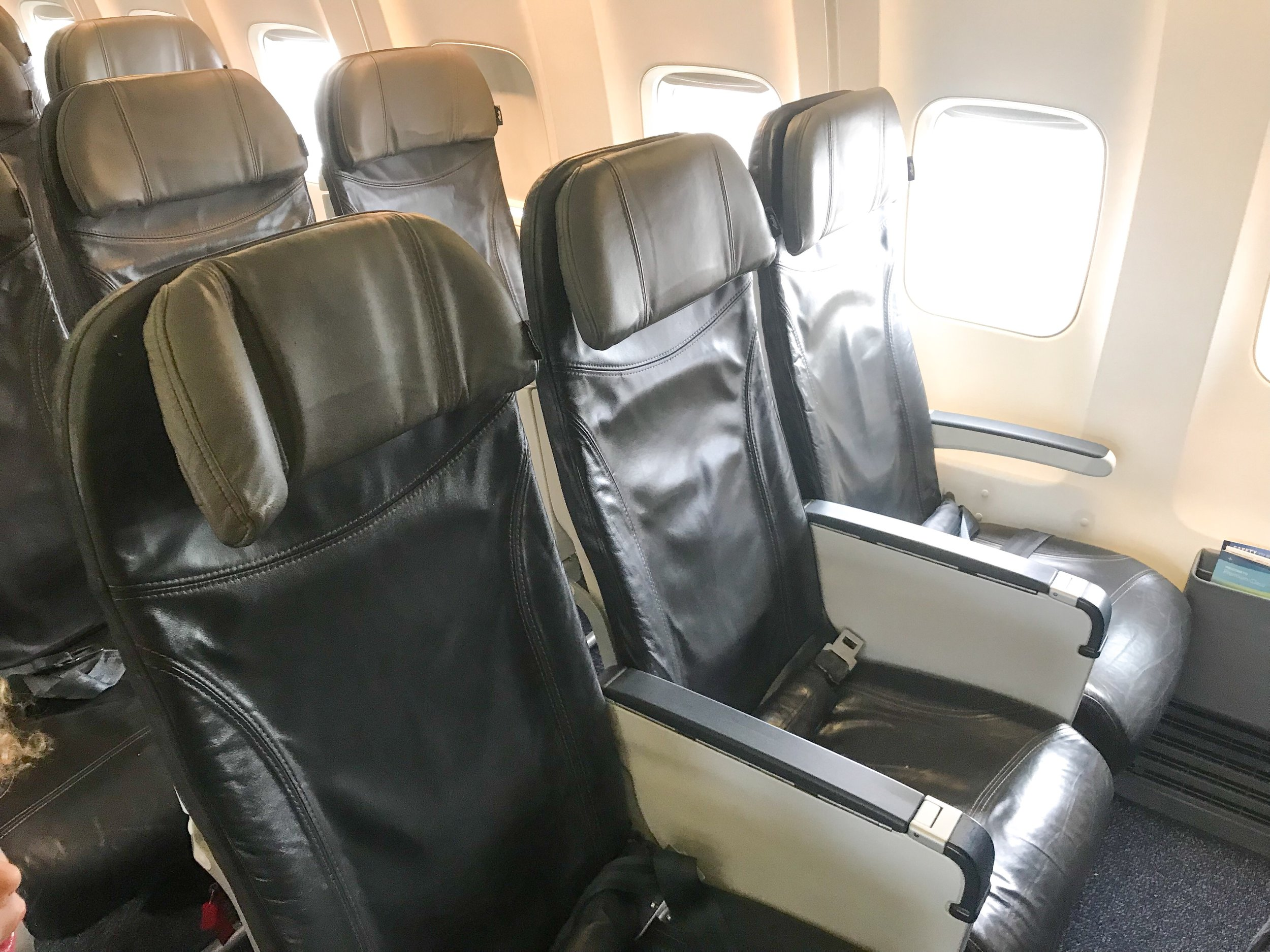 The seats feature moveable headrests. They were comfortable, but seemed slightly worn down and tired. There is no seat back Inflight Entertainment system, but free streaming content is available to personal devices.