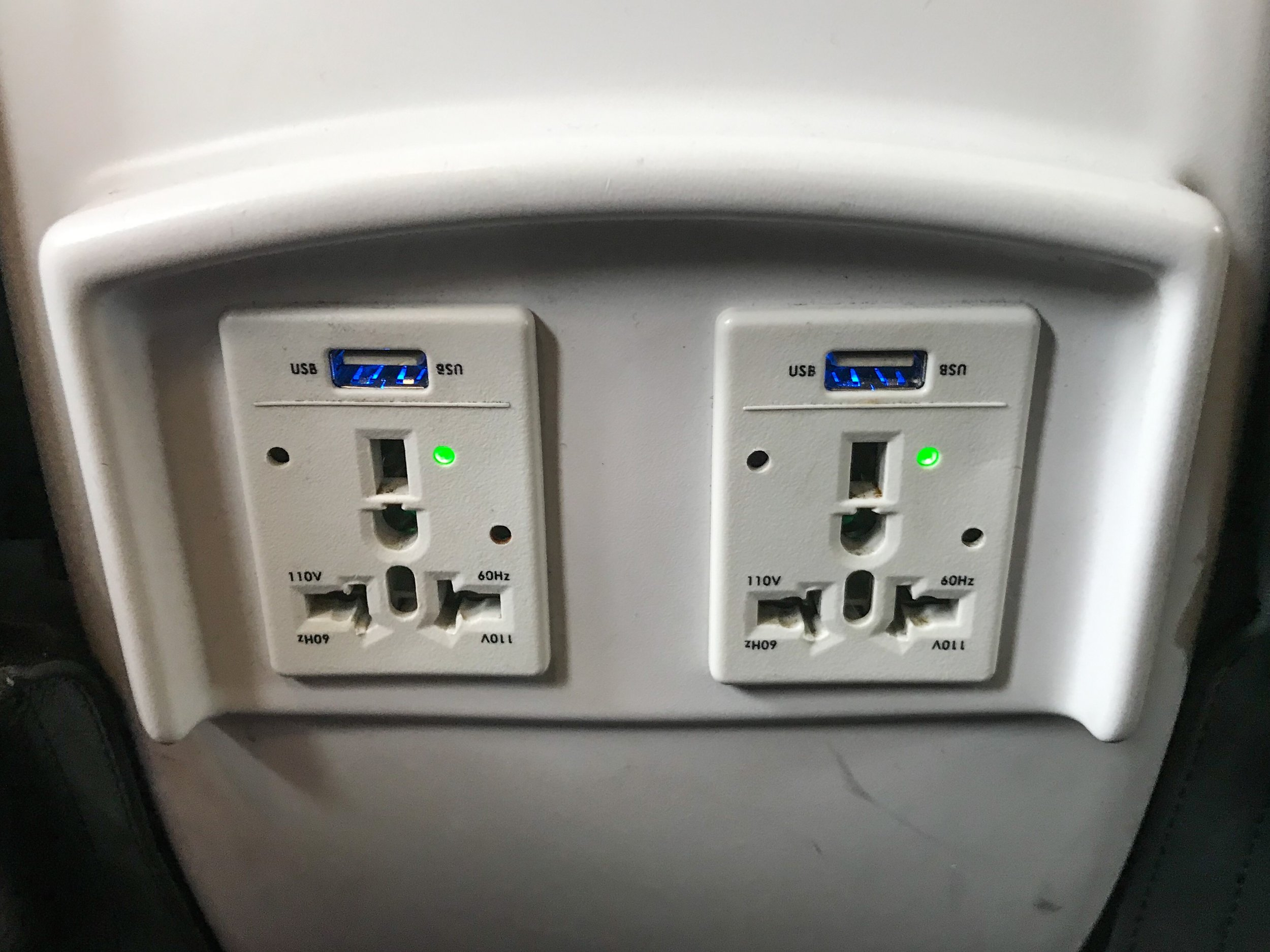 There are two 110V universal style power outlets and USB power ports in each row.
