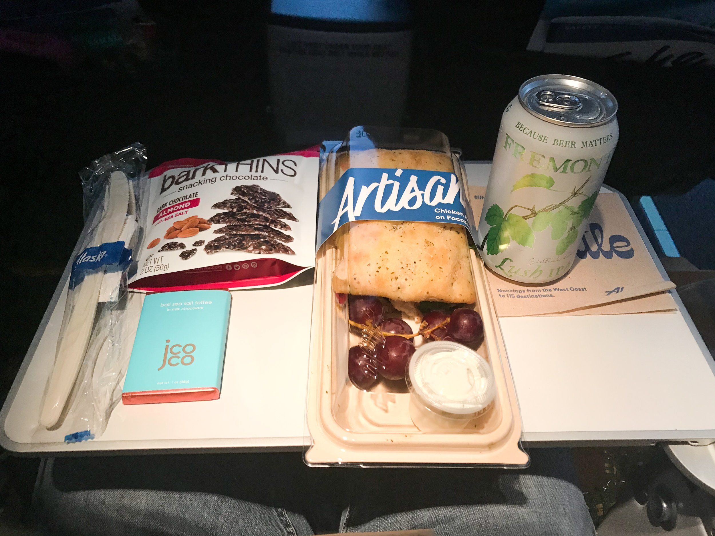 What a feast! Premium Class passengers receive complimentary alcoholic beverages and premium snacks (the barkthins). As an MVP Gold I also received the milk chocolate bar. The flight attendant thanked me for being a Gold member before handing it to me. I had pre-ordered the chicken pesto sandwich to give it a try. It wasn't very good, especially for $9.50. The sandwich was very dry and kind of bland. I suggest spending that money for food at the airport or just bring your own, rather than paying for food onboard.