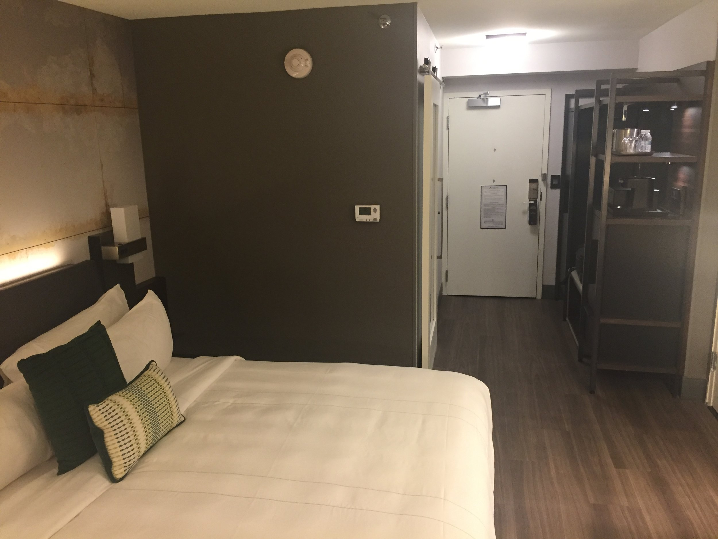 A convenience center included a wardrobe, drawers, safe, small refrigerator, a coffee station and space for a suitcase to be opened. The only carpeting was a small rug next to one side of the bed, so room cleanliness was outstanding.
