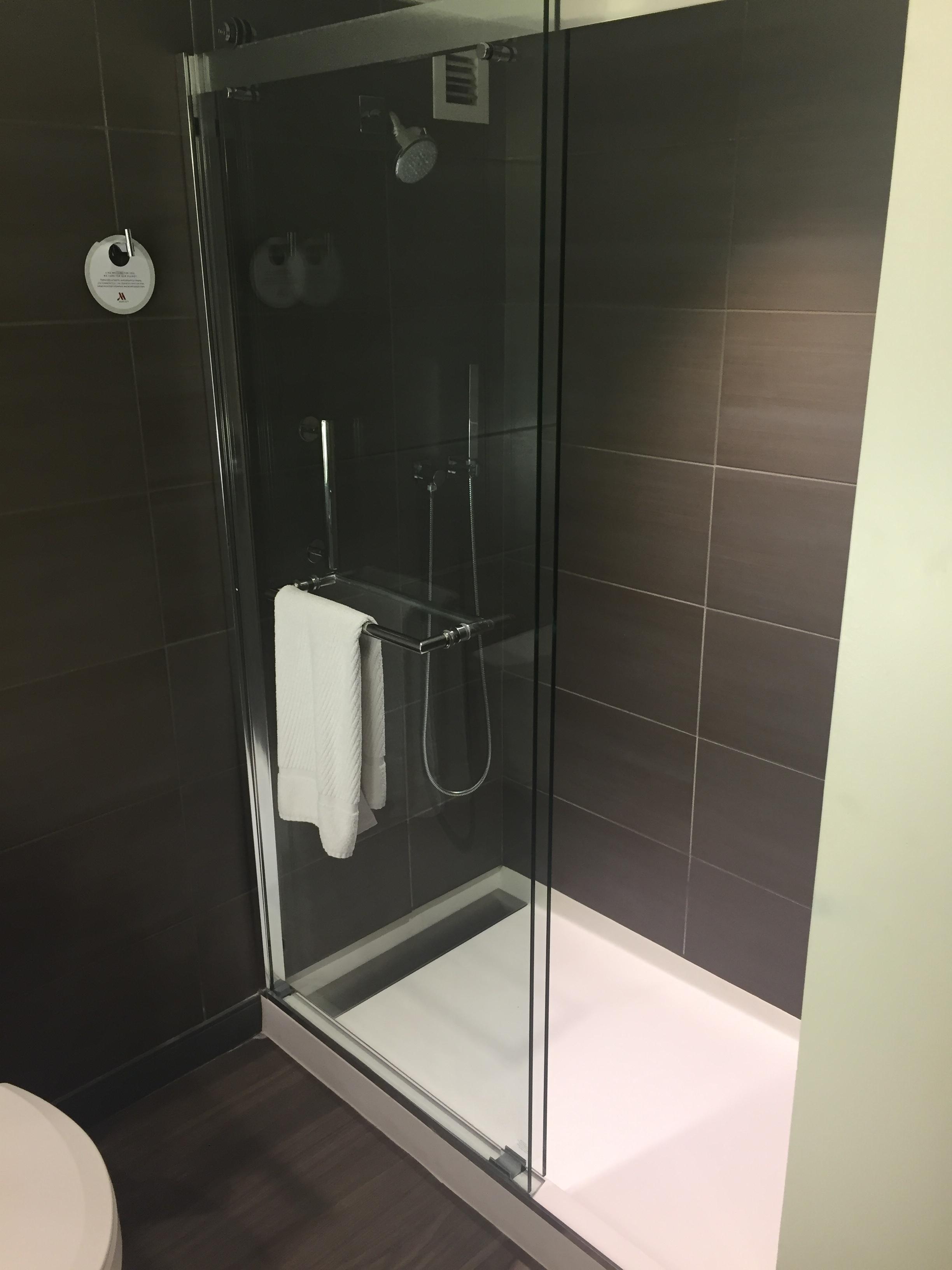 Multiple shower heads in the walk-in shower.