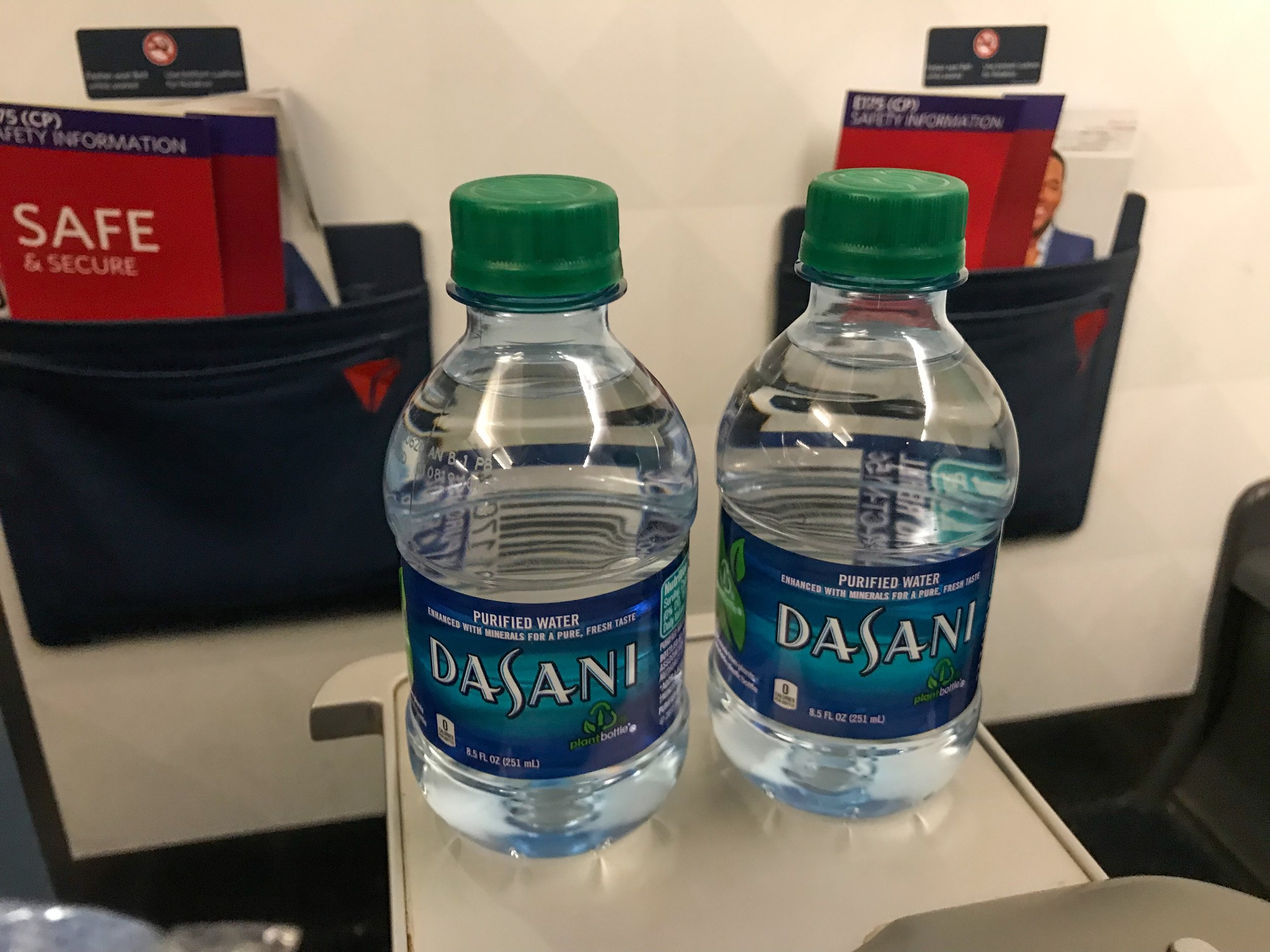 First Class passengers are provided Dasani water bottles, in addition to pre-departure beverage service (both alcoholic and non-alcoholic). Though, due to the delay, pre-departure service was suspended on this flight in order to expedite departure.