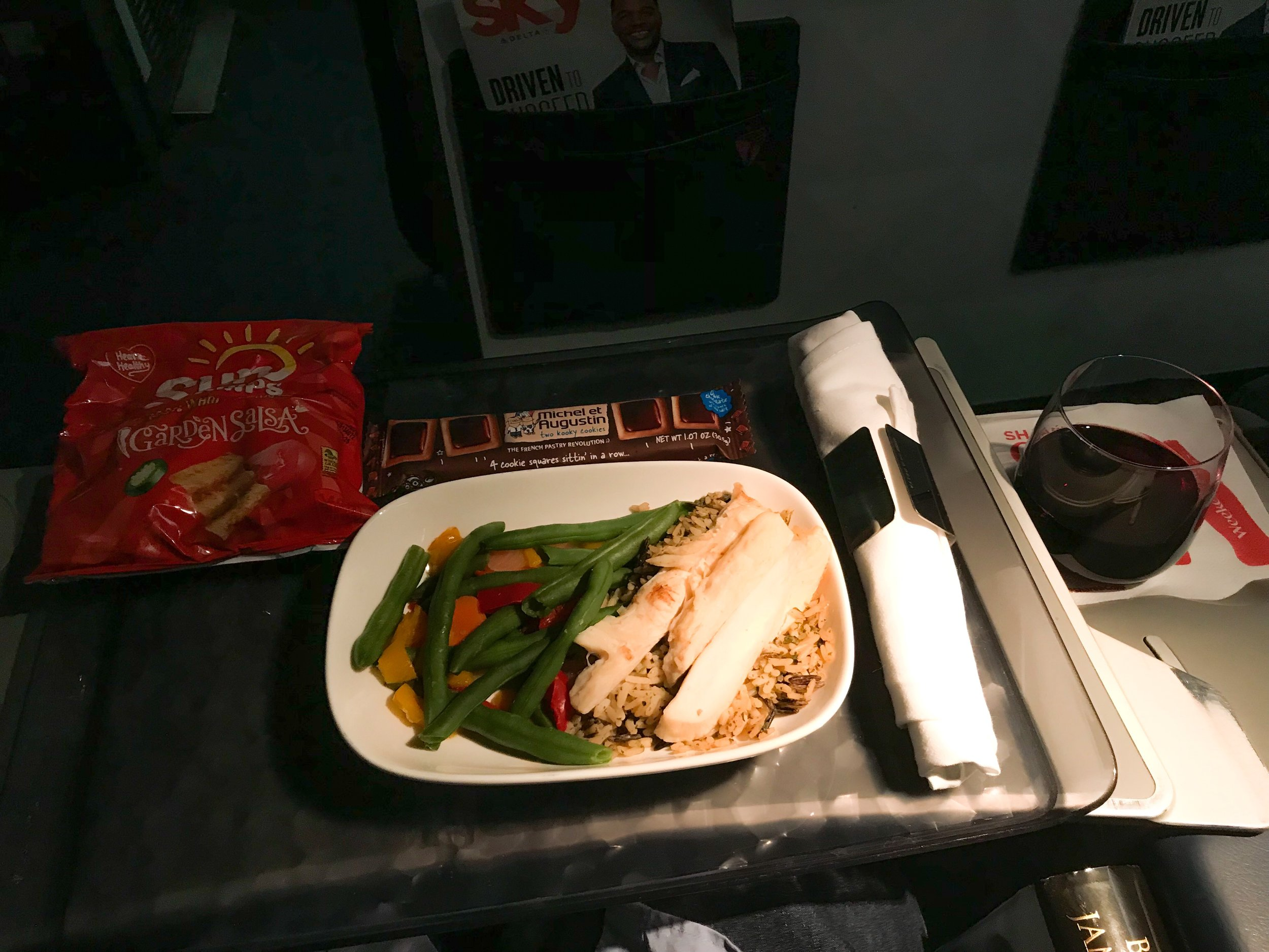 Meals on the ERJ-175 are not as robust as on Mainline Delta flights, due to the smaller galley. There are typically two meal options - sometimes offered from the front of the cabin to the back, and sometimes opposite. There is really no way of predicting where they will start, so be prepared to only have one choice if you're in Row 1 and they start in the back.