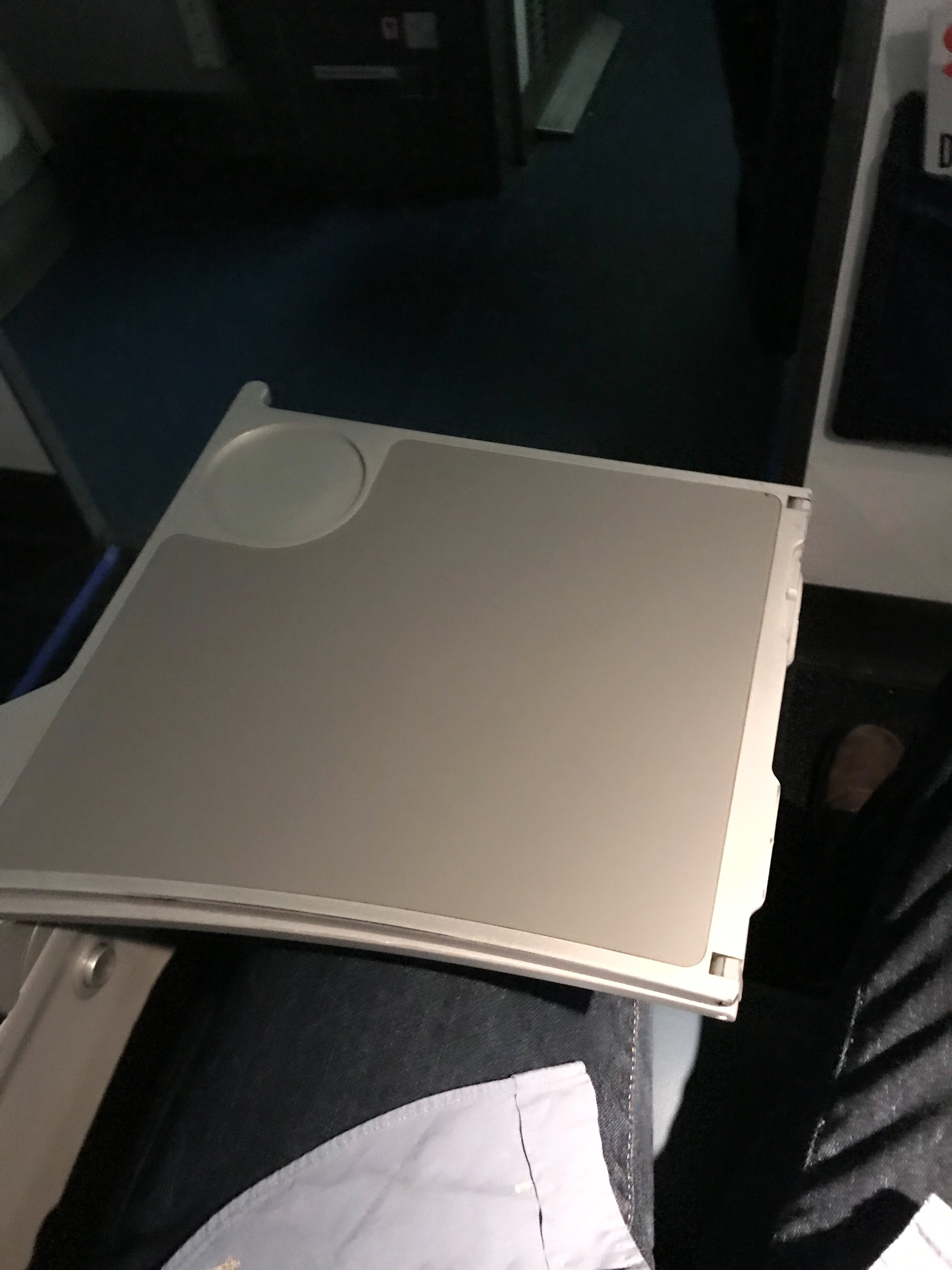 The tray table folds out of the armrest.