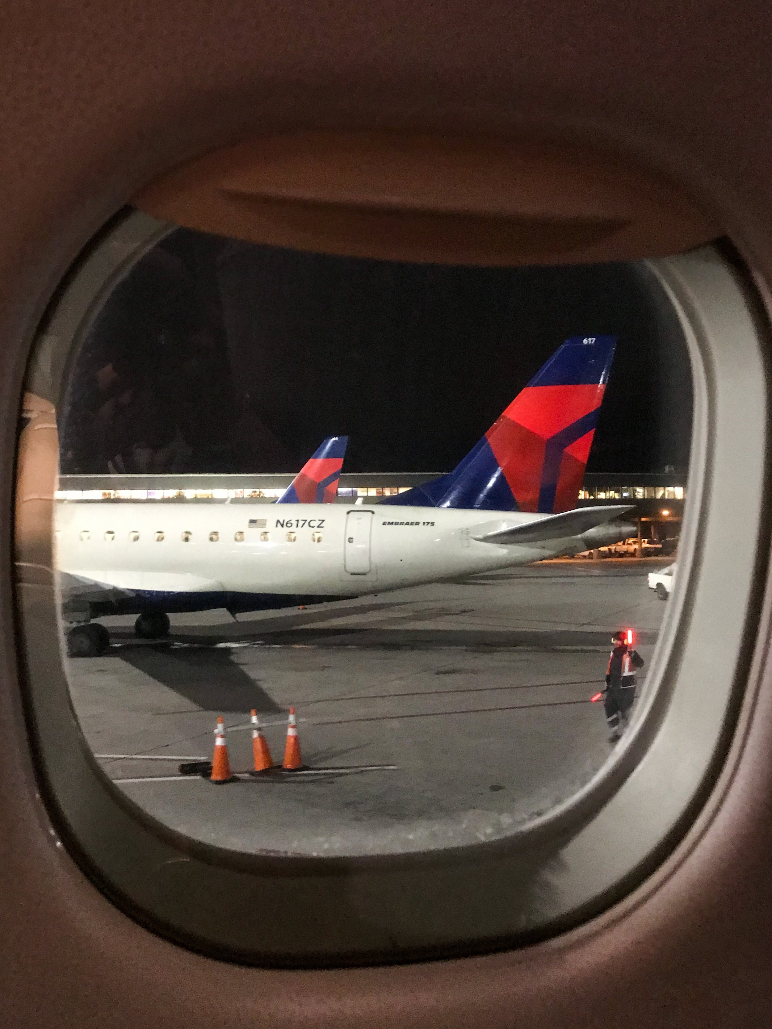 Parked next to two other ERJ-175s on the ground in Salt Lake City.