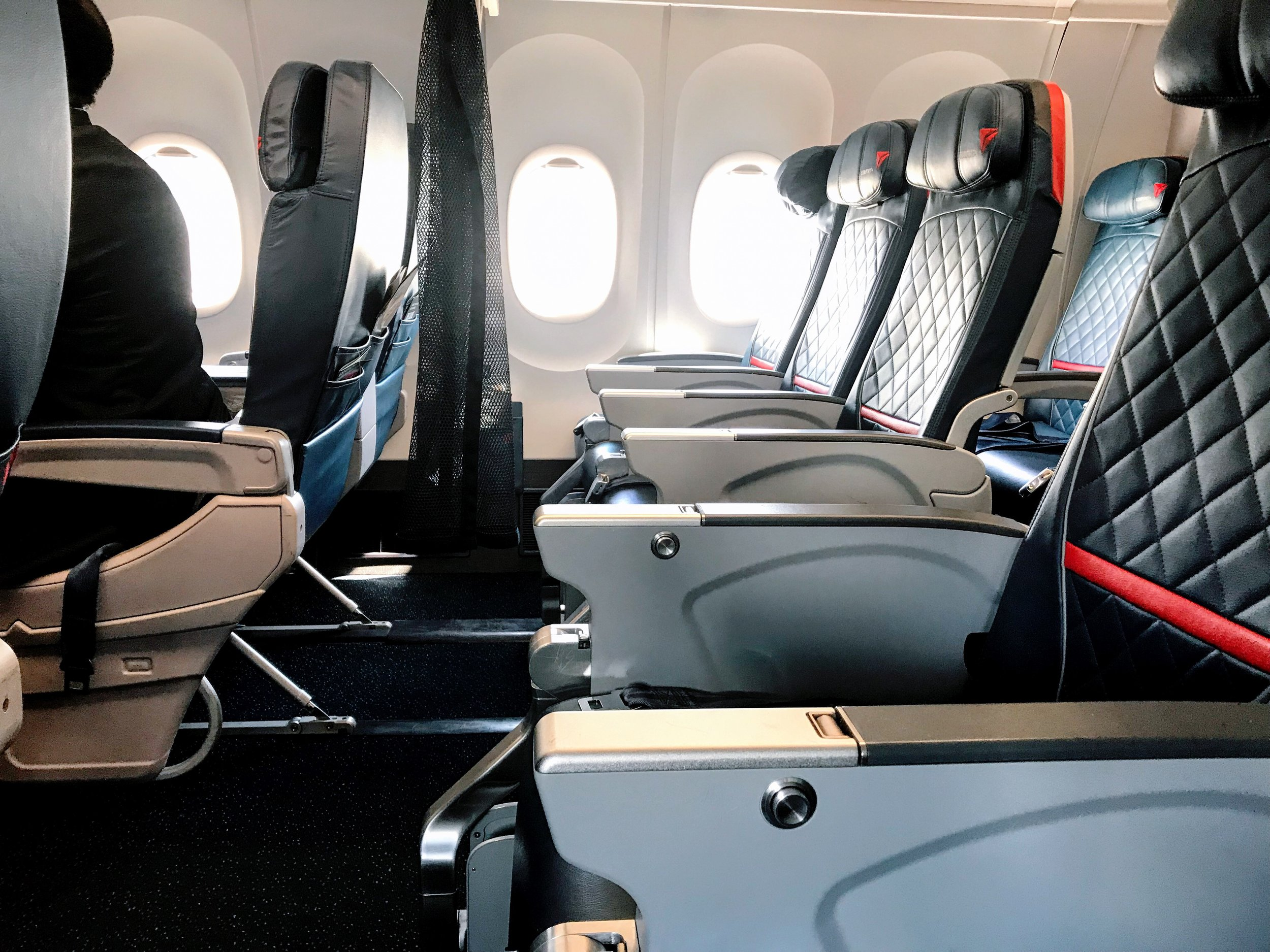 The first row of Delta Comfort+ features additional legroom due to the lack of a hard bulkhead behind the last row of First Class seats. Try to snag these seats if at all possible.