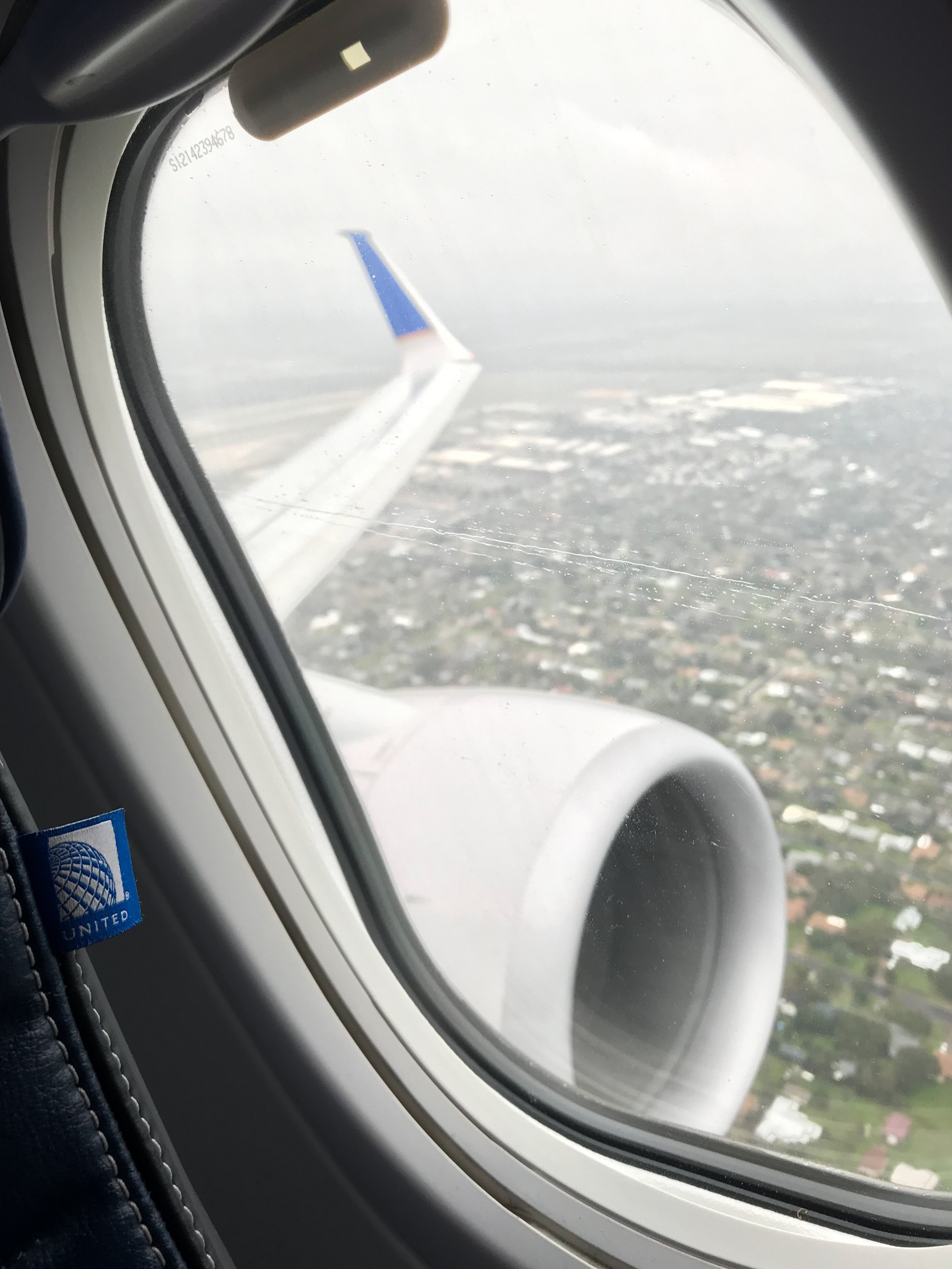 Climbing out of San Antonio. The United tag on the seat is a nice touch.