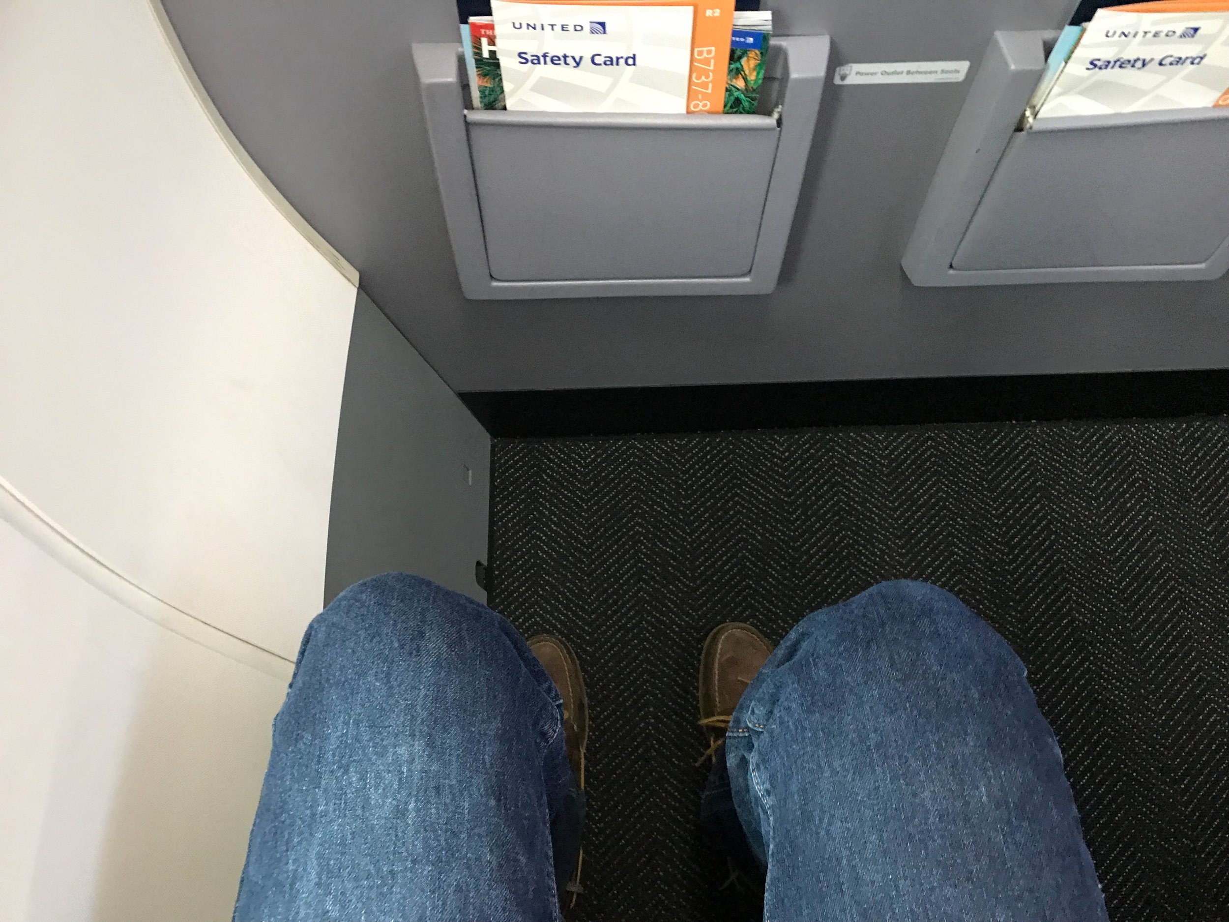 Despite the position of the bulkhead, there was ample legroom. More than any other row in Economy Plus.