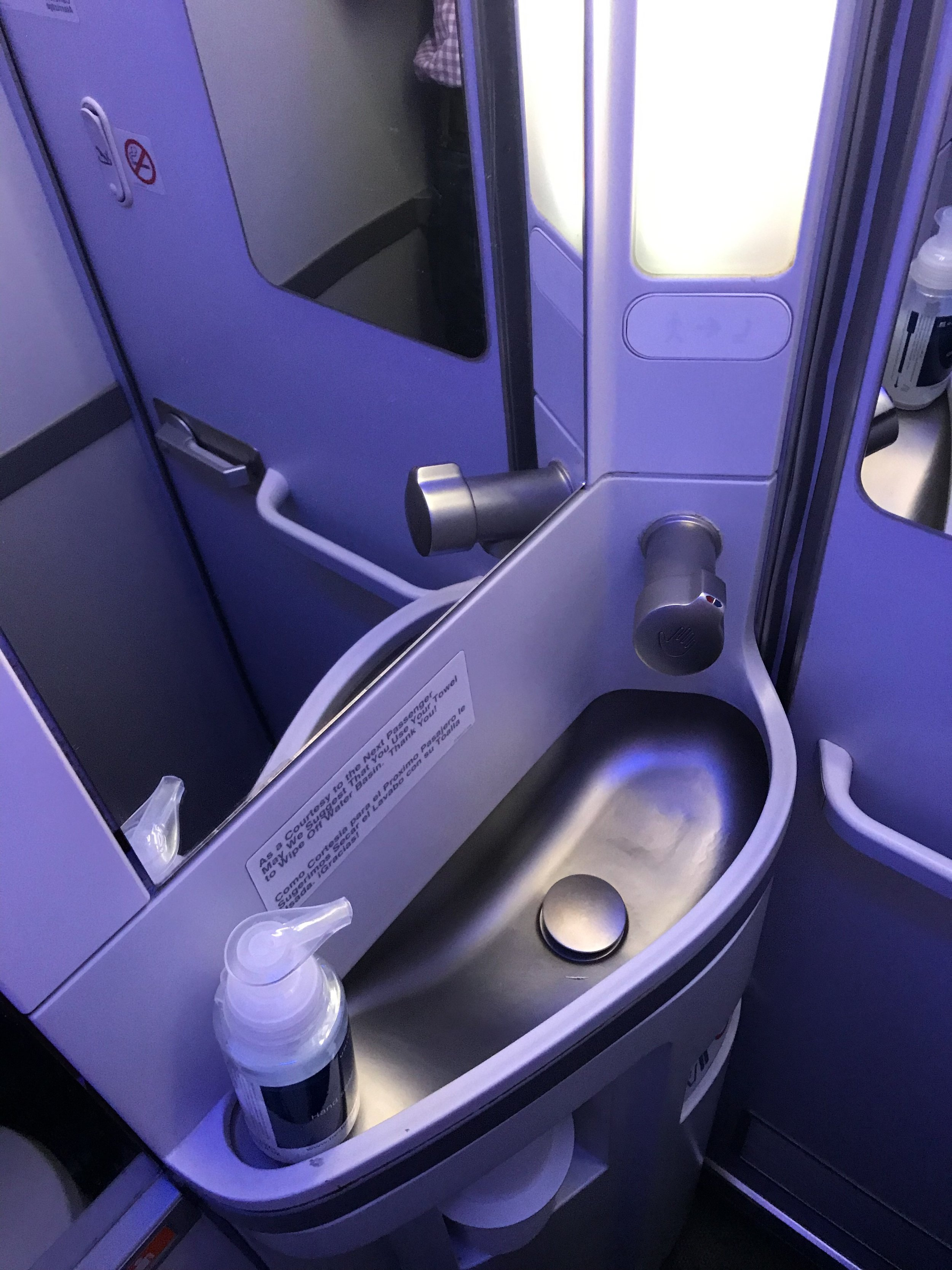 The mid-cabin lavatory was clean, but very tight.