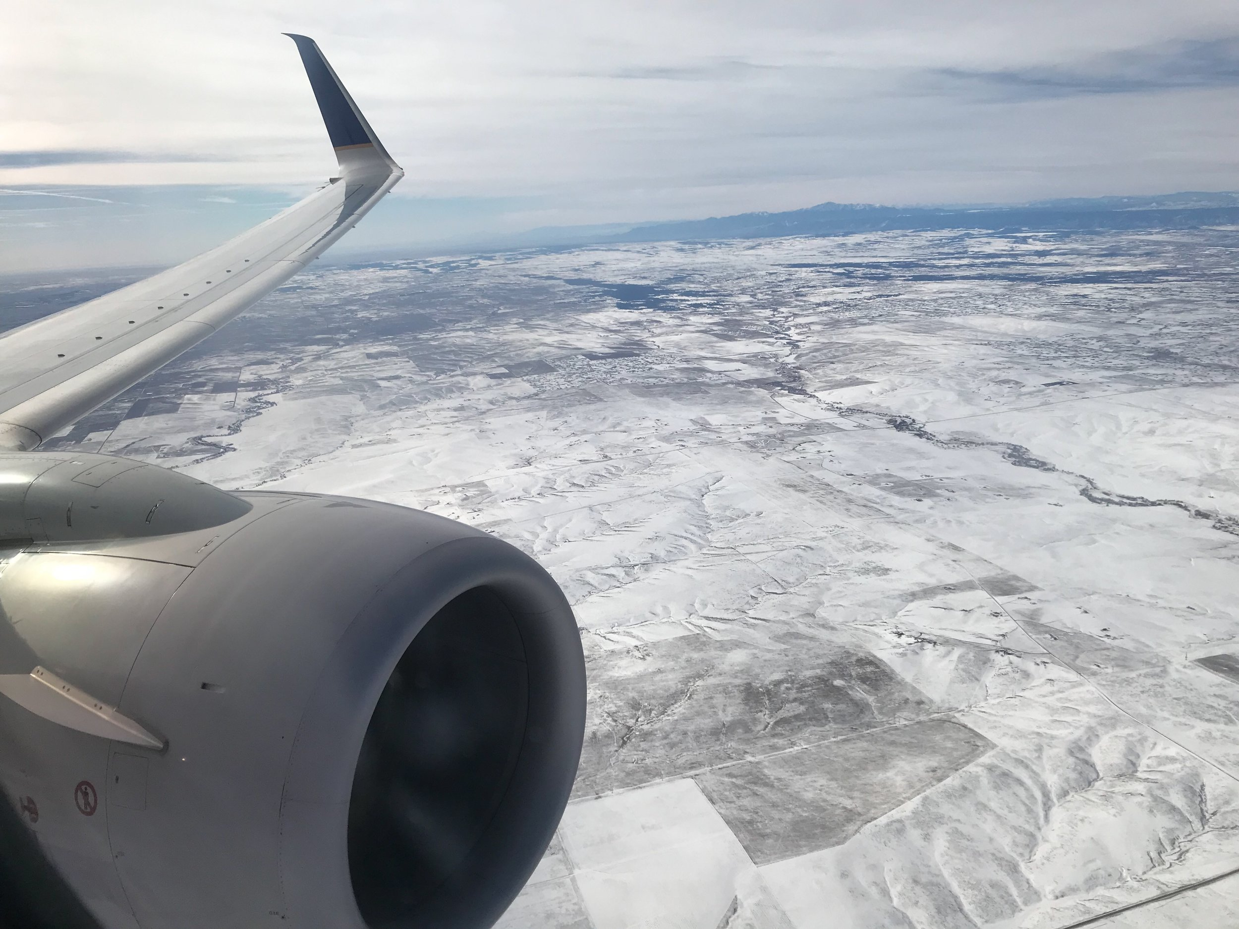 Arriving in a snowy Denver.