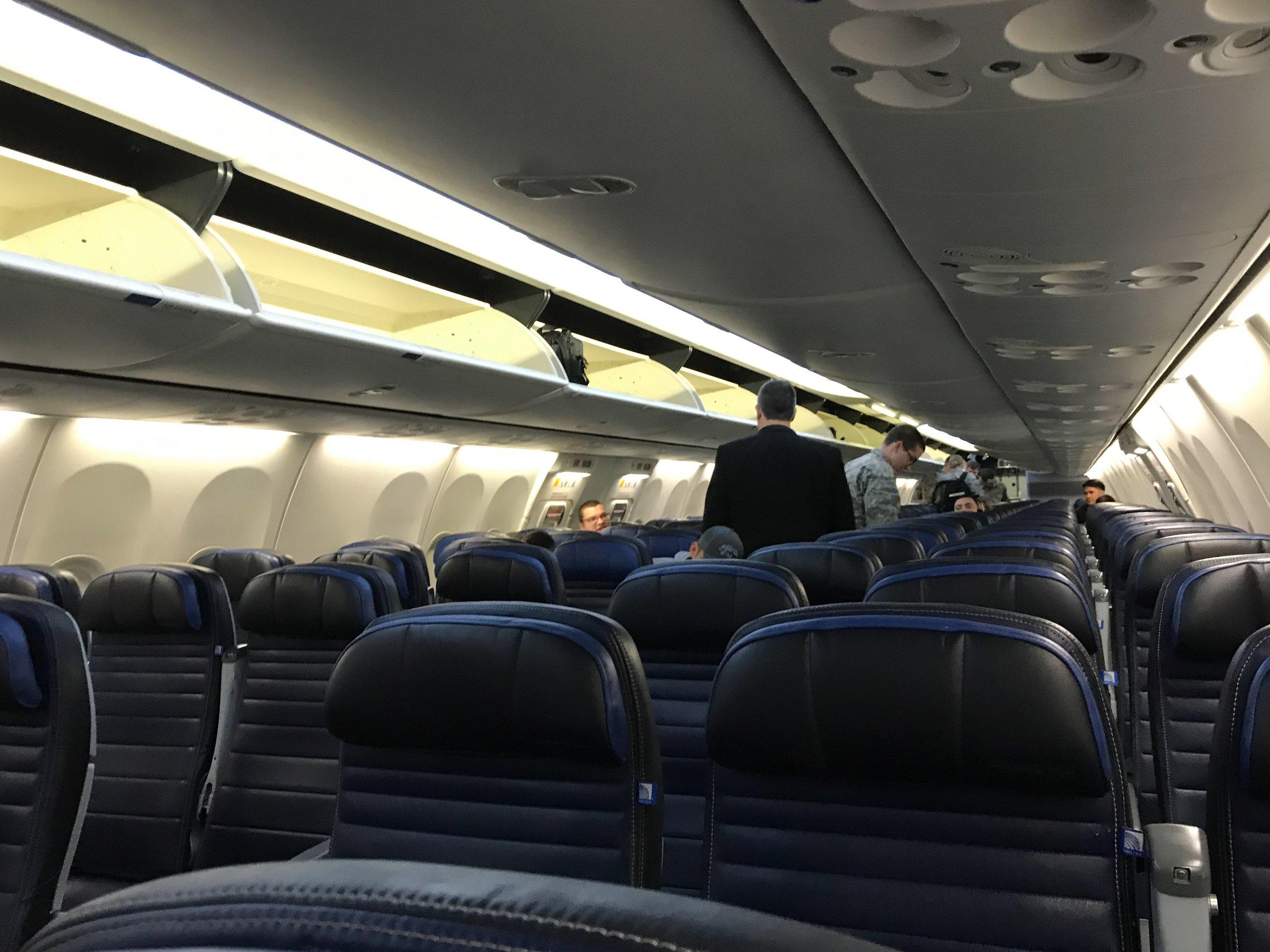 United Economy Plus 737 900 San Antonio Denver Officer Wayfinder