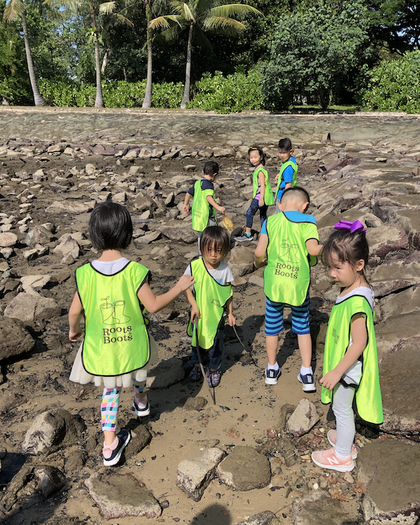 Exploring a mudflat during low tide. At the same time, helping to collect trash.