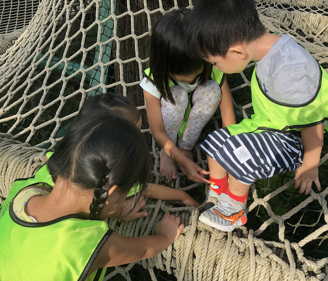 Helping a friend whose shoes were stuck in the net.