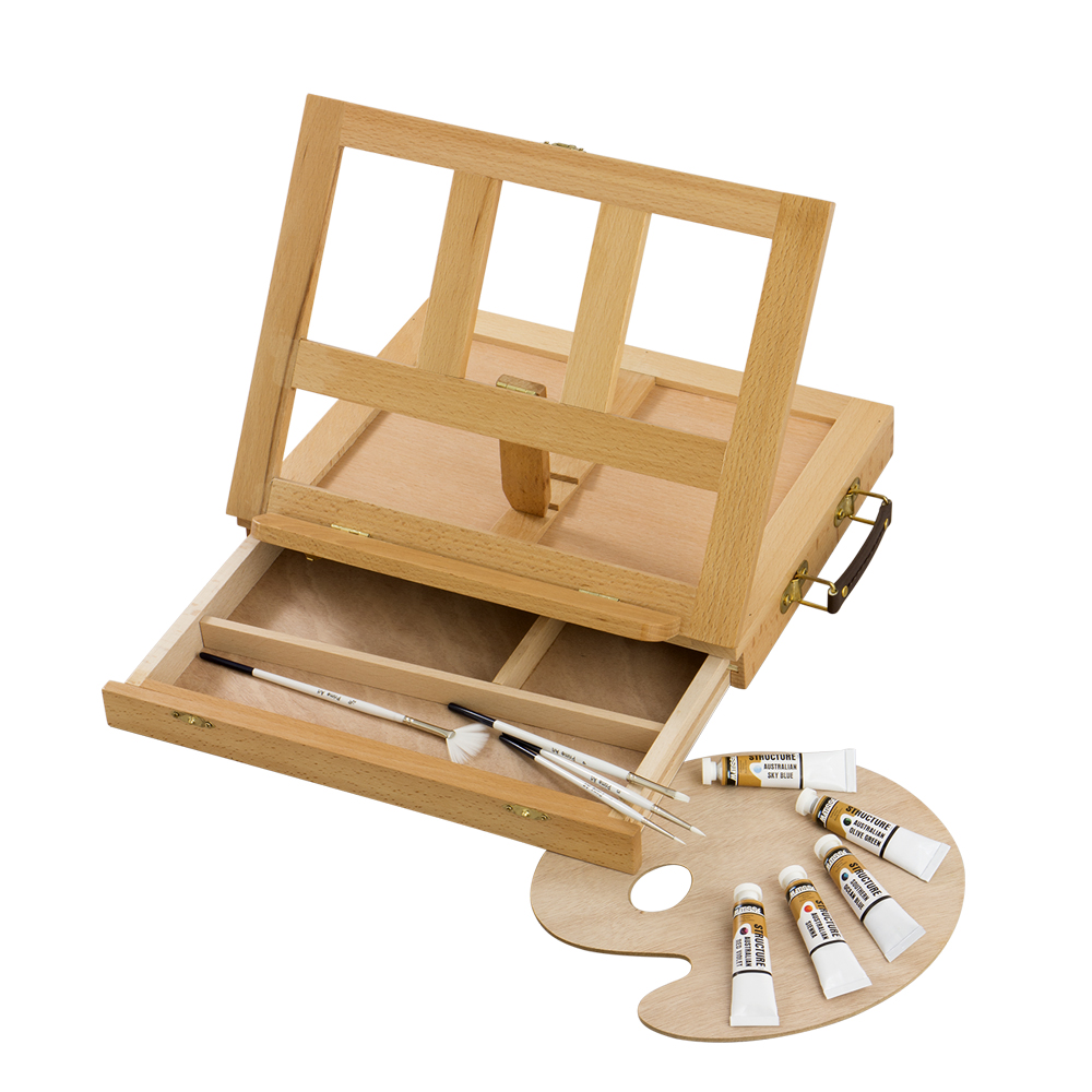 SMALL TABLE BOX EASEL    4BE336430   • Size: 34x26x5(28)cm.   •  Beechwood   • Varnished.   • Front drawer with compartments for brushes and paints. .  •  Wooden palette, carry handle.   •  Suitable for small painting or drawing studies, display of artworks or as a bookstand.