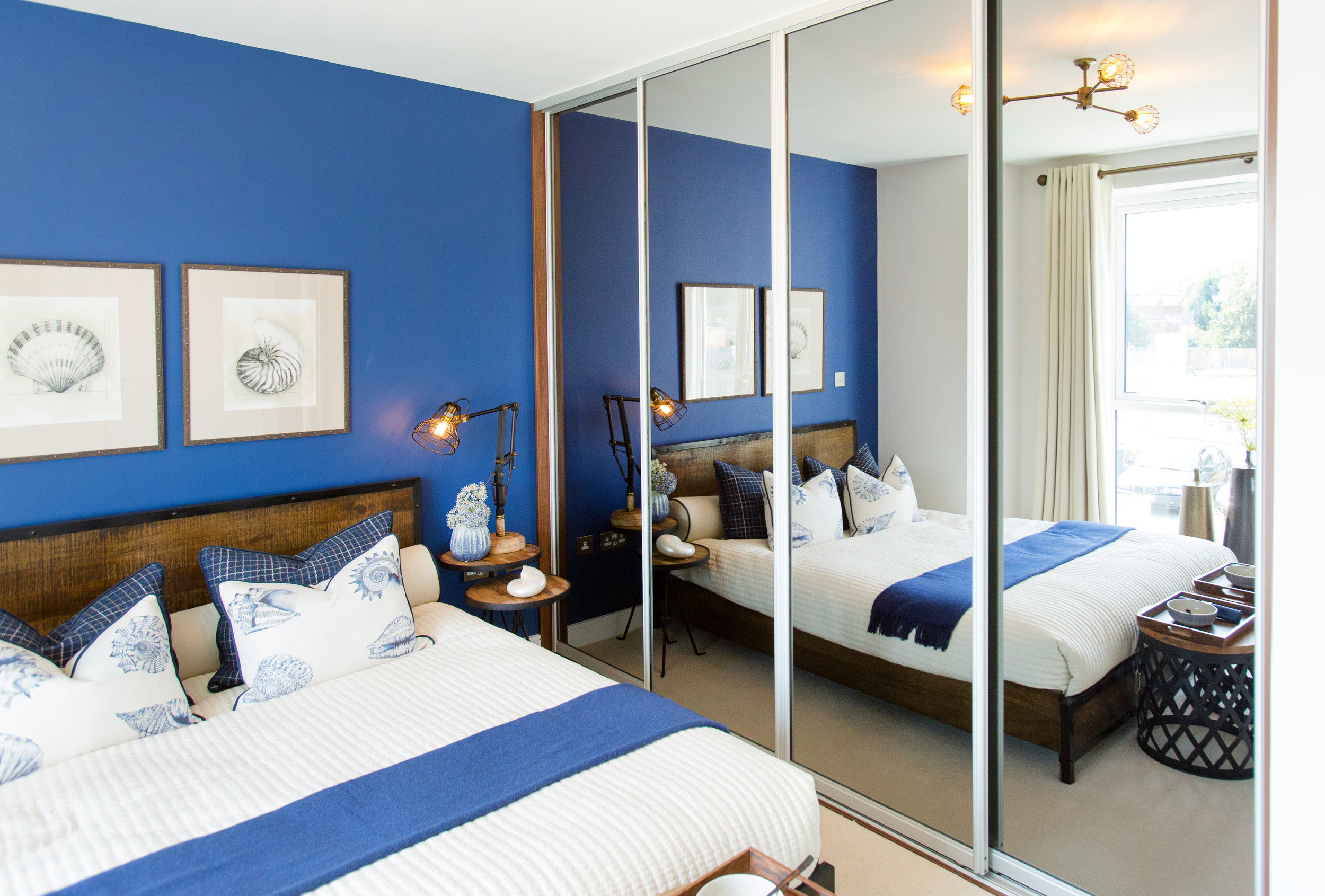 Dress your showhome master bedroom to impress with sliding wardrobes from Global Doors.