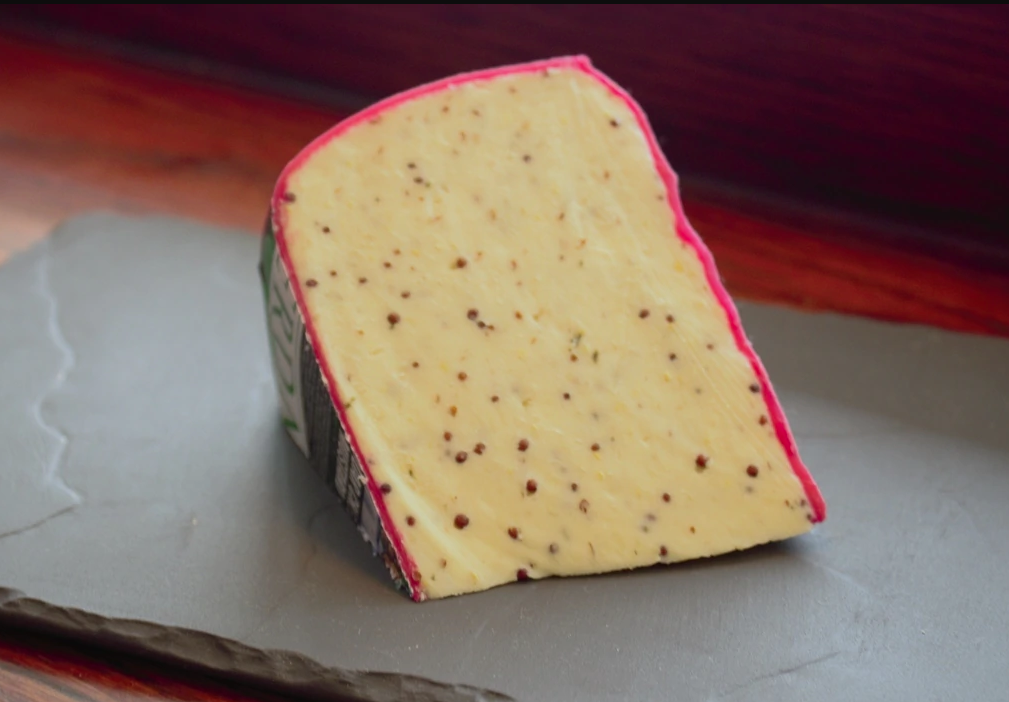 Red Lion - A smooth, firm, tasty Cheddar is blended with wholegrain mustard seeds and ale. Wrapped in red wax and aged for 3 months Red Lion is a buttery cheese with plenty of bite.Suitable for vegetarians$6.60 per 100g