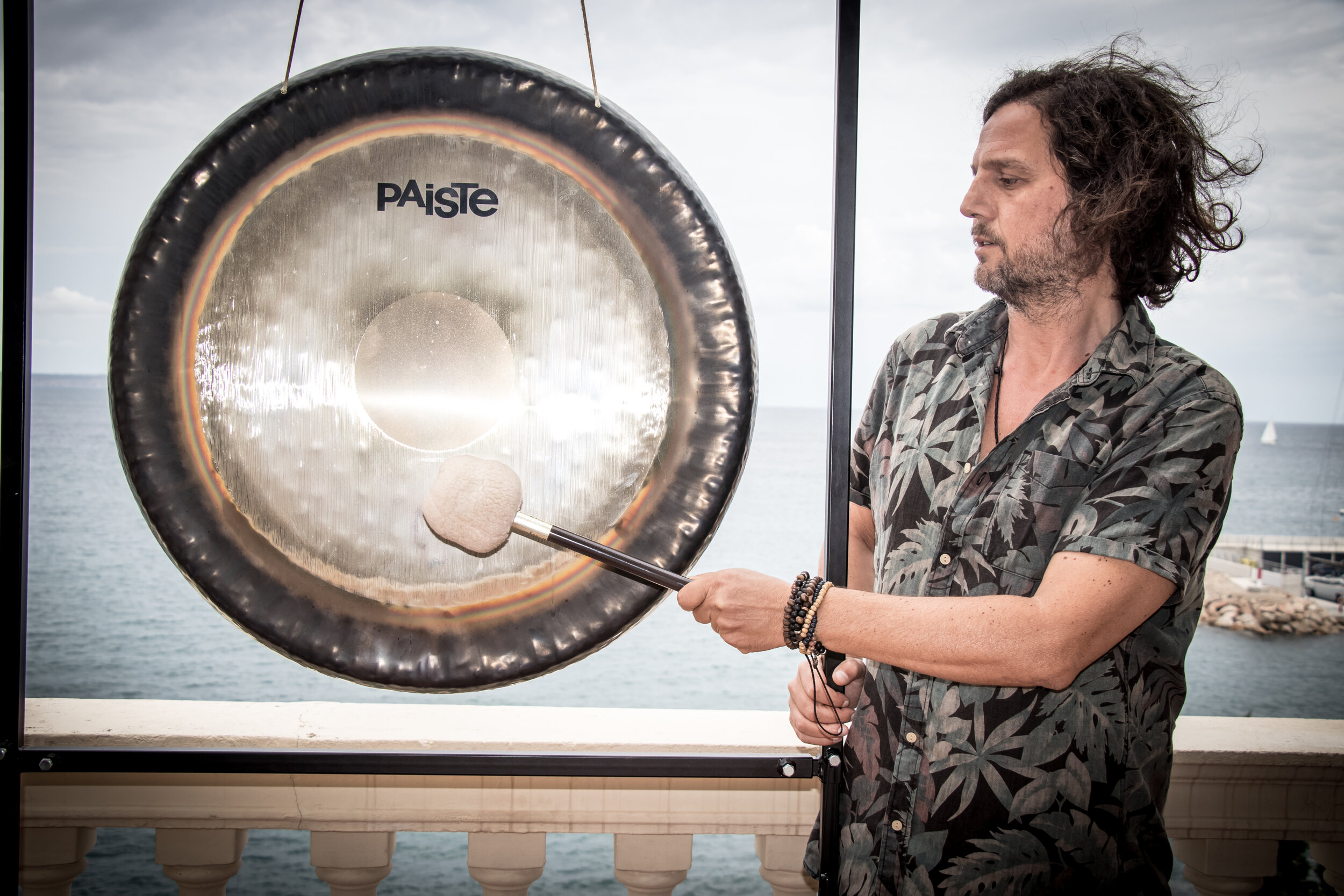 """Gongoro - Gongoro is an Italian professional gong player. He lives between Mallorca and Tulum. He comes from Adinadd Art Gong School, based with Yogi Bhajan's Teaching. With more of 300 hours he graduated as a sound therapist of gong in Tulum (Mexico) with the gong master Har Harí.Gong is really powerful because Gong vibration (through neutral mind) comes from the universe and transmits regenerative energy to all the cells of the body.By means of this universal vibration, we can remove old traumas and fears starting your own healing. Moreover we can get in touch with our higher self, awakening intuition and telepathy. You are invited to join the gong bath every day at 5pm""""Gong is always like sun"""" Yogi Bhajan"""