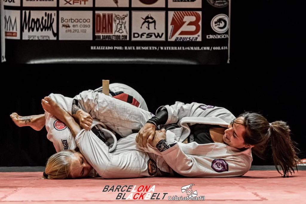 Lilo Asensi - Lilo has stepped in to replace Ffion Davies. Lilio is from Alicante, Spain and for three years has been living in Hamburg teaching BJJ at KB gym and Budu point She is also active on the competition scene as a referee. Lilo was the first woman in Spain to get the black belt in BJJ. Last year she received her second grade from the Climent brothers.-2019 Bronze European Champion Black Belt-2018 gold Naga European black belt with gi and 2nd Expert NoGi-2015 silver Master world champion Black belt 2015 Pan American silver No gi