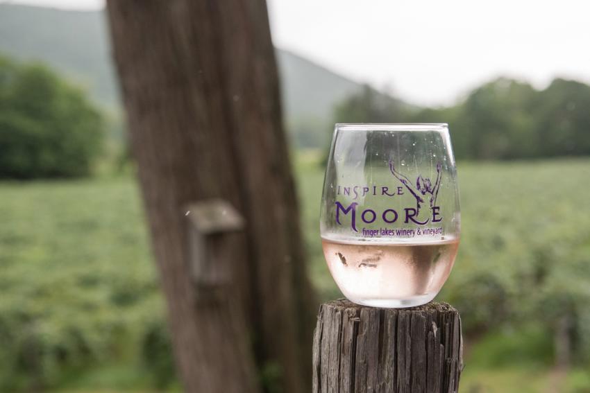 Inspire Moore wine glass overlooks the vineyard. Photo: Visit Finger Lakes